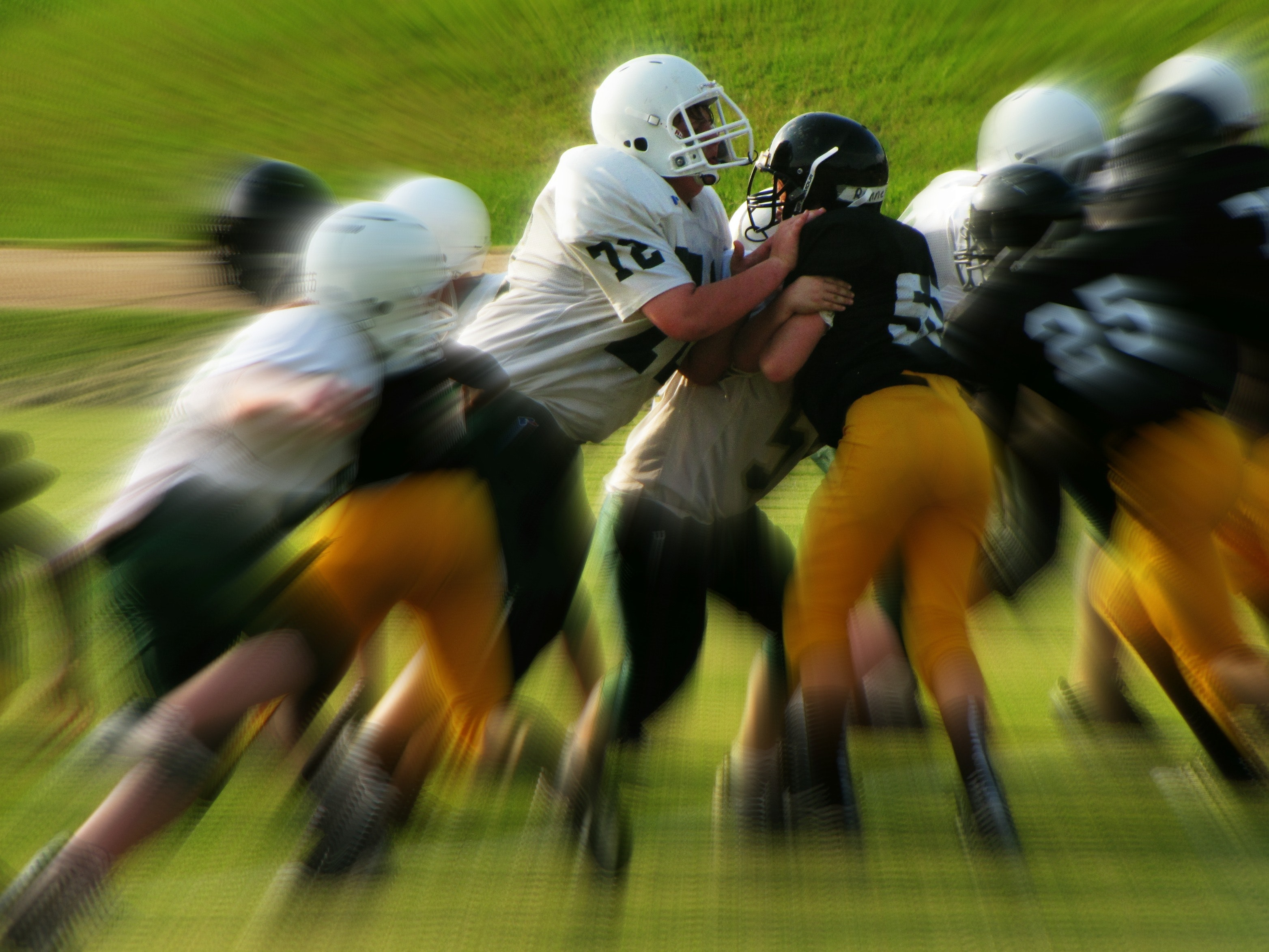 Men in white and black playing football photo