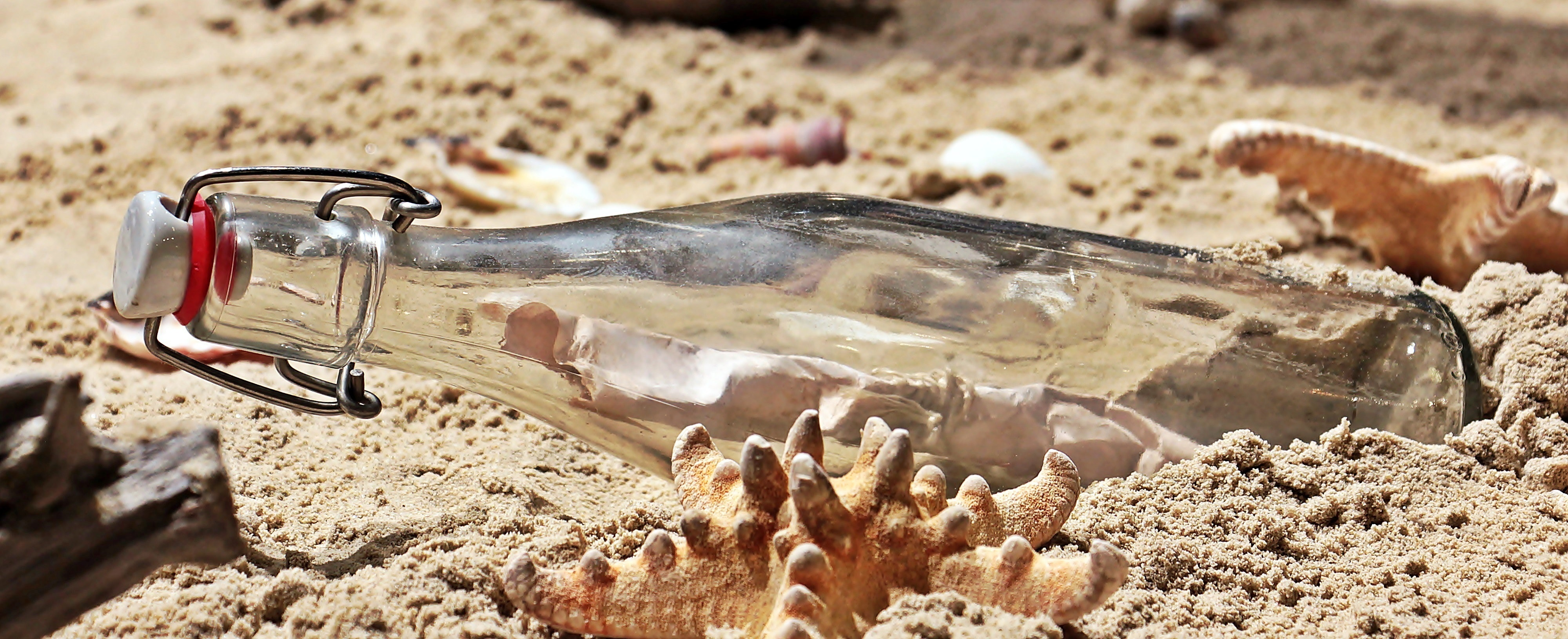 Message in a bottle on sand photo