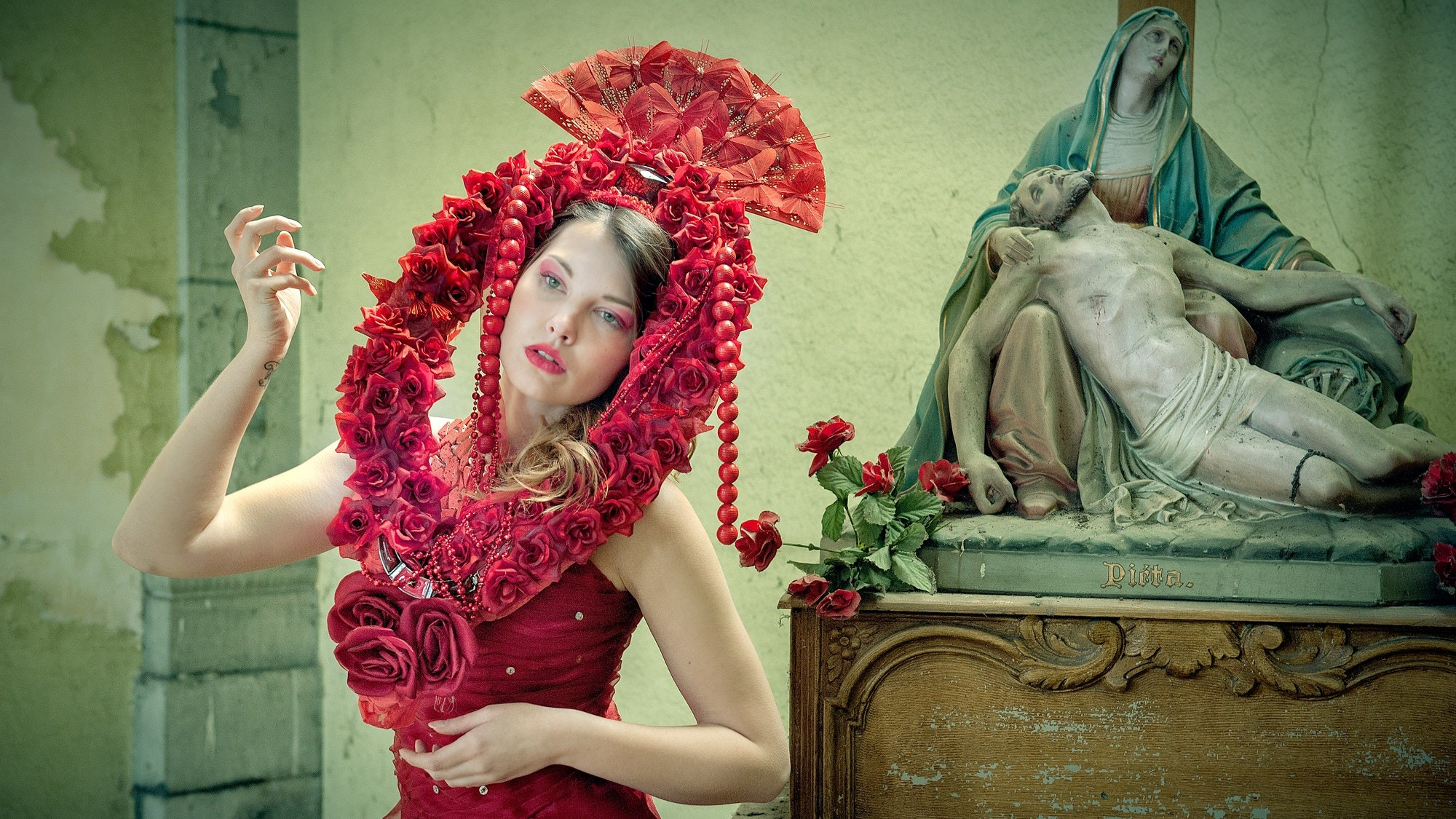 Midsection of woman wearing red flower photo