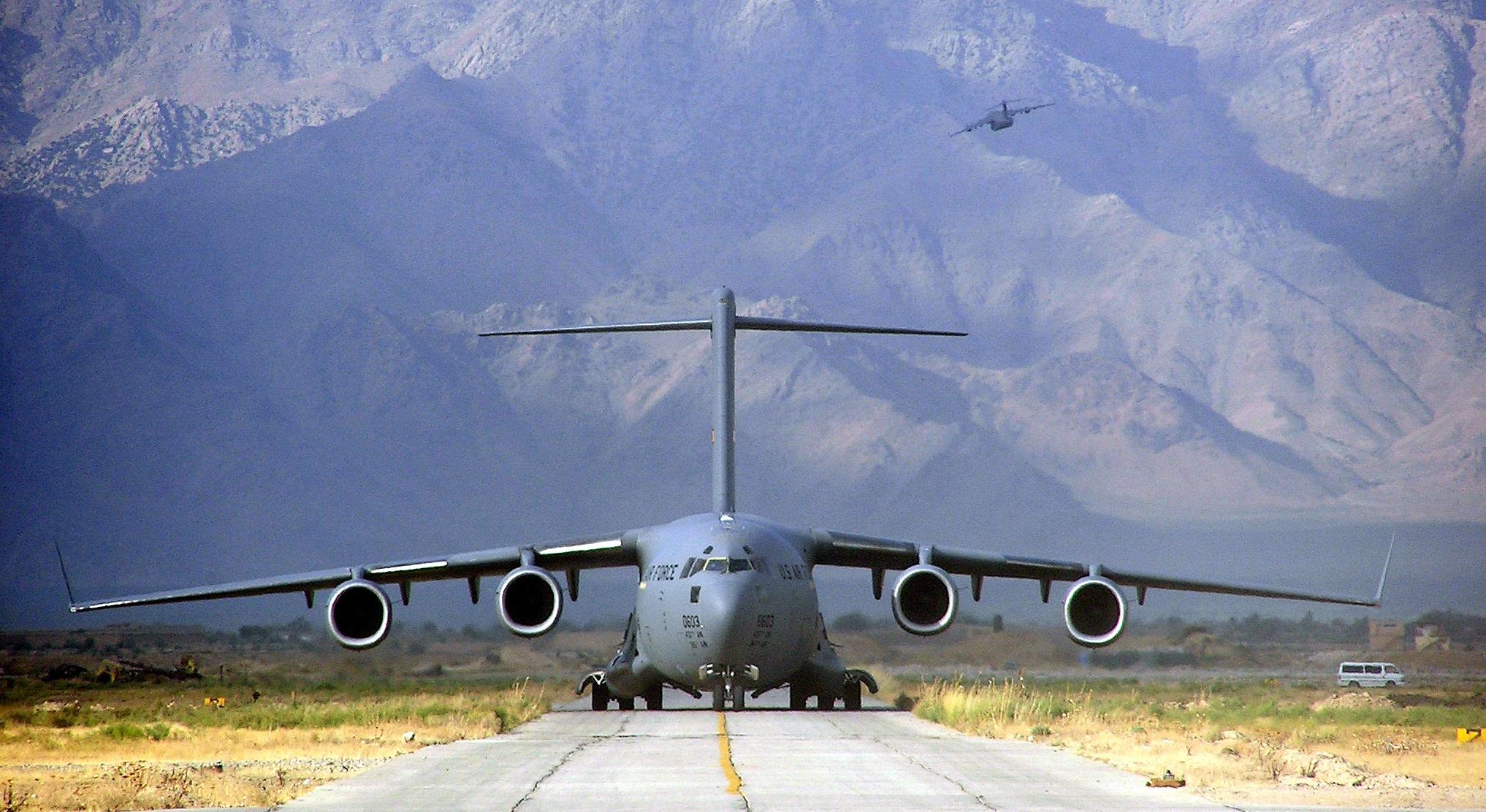 Military cargo plane takeoff photo