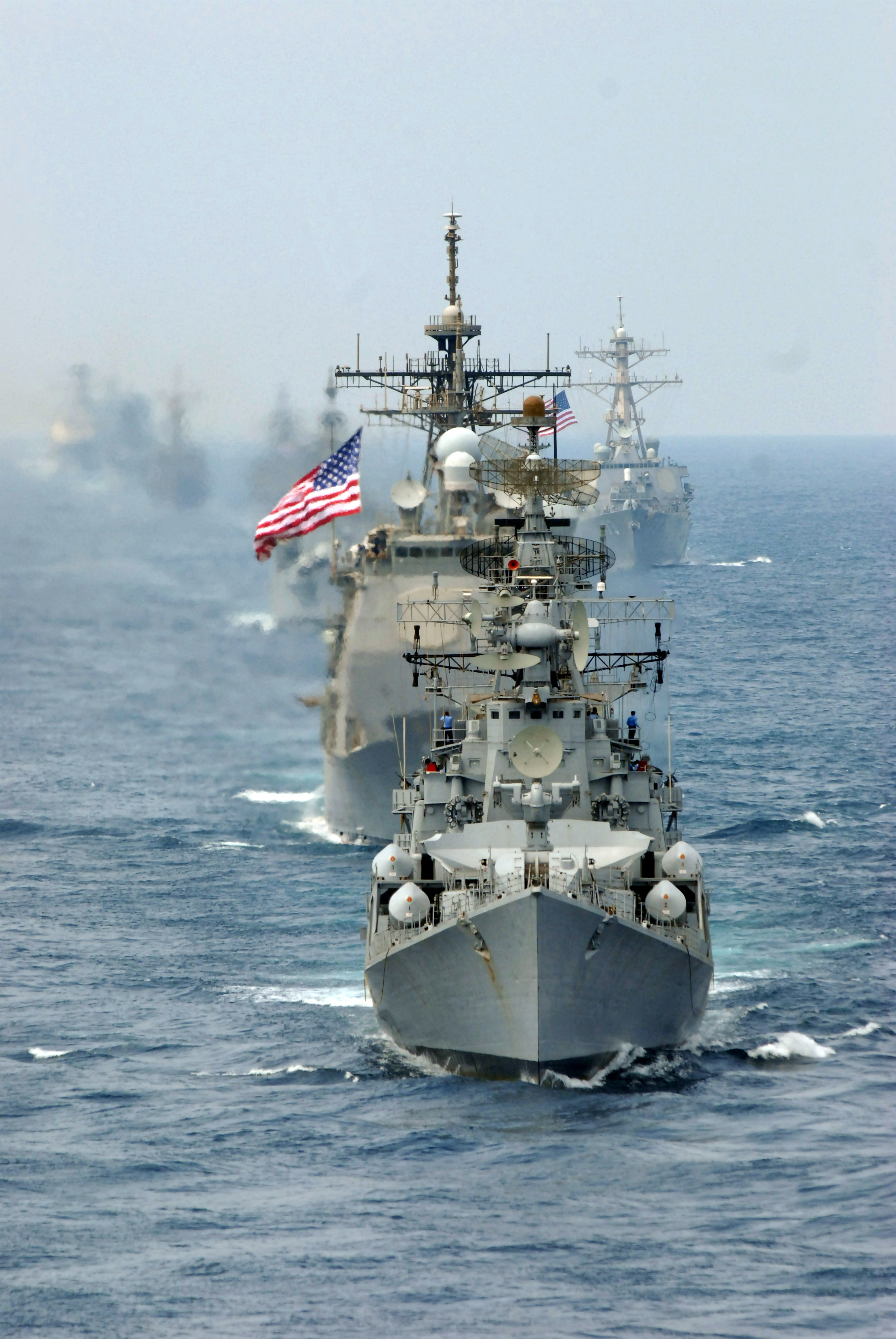 A Line of Military Ships Traveling in a Large Group Stock ...