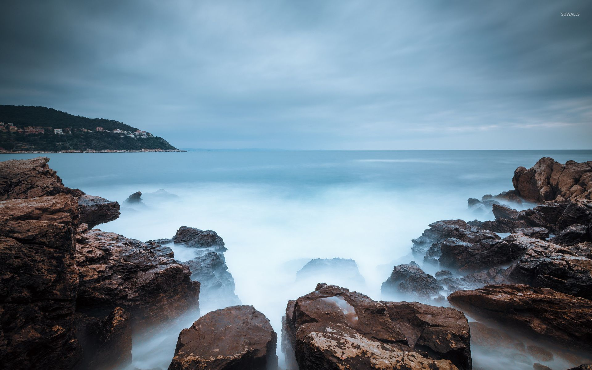 Misty water reaching to the rocky shore wallpaper - Beach wallpapers ...