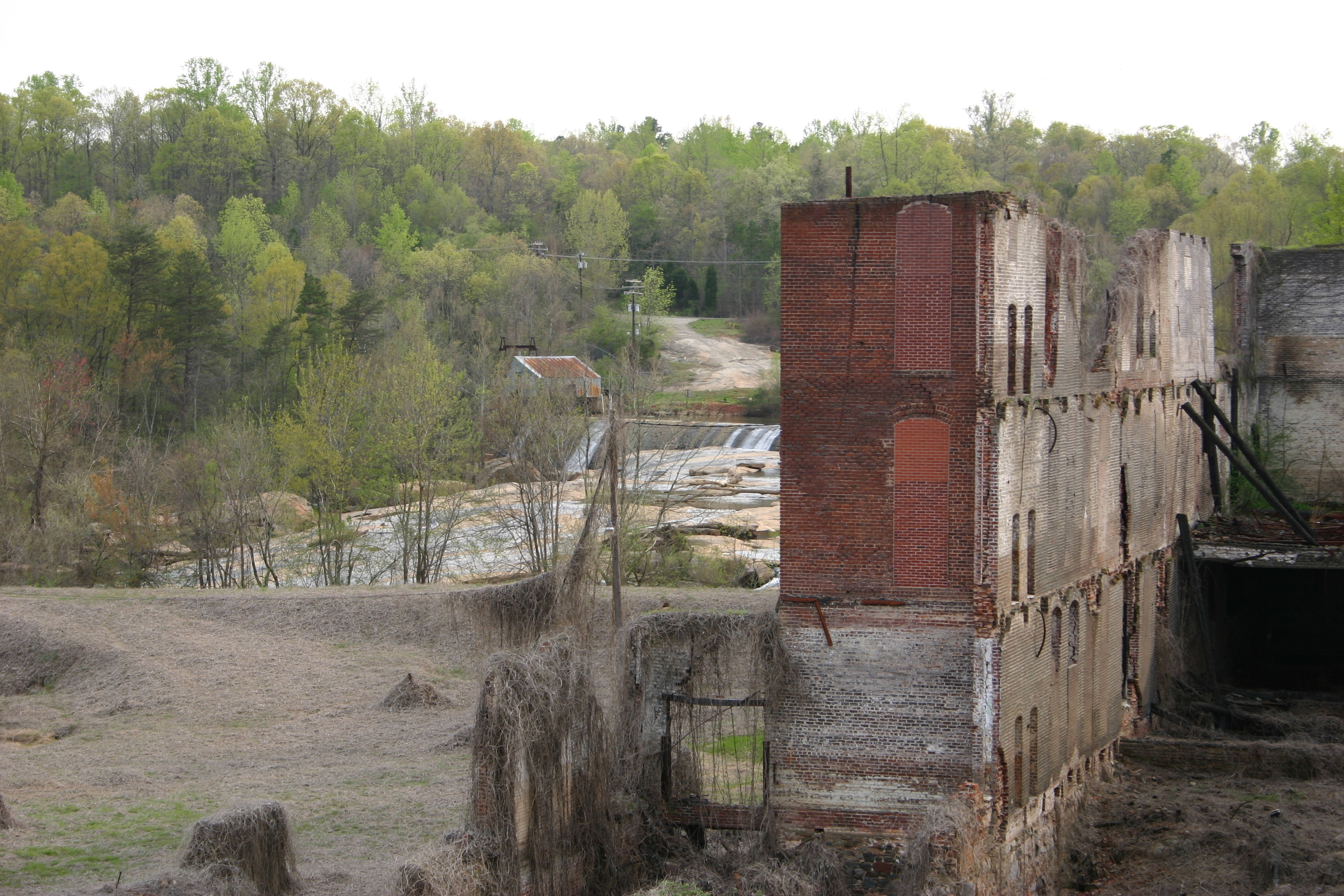 Modern ruins over looking a river photo