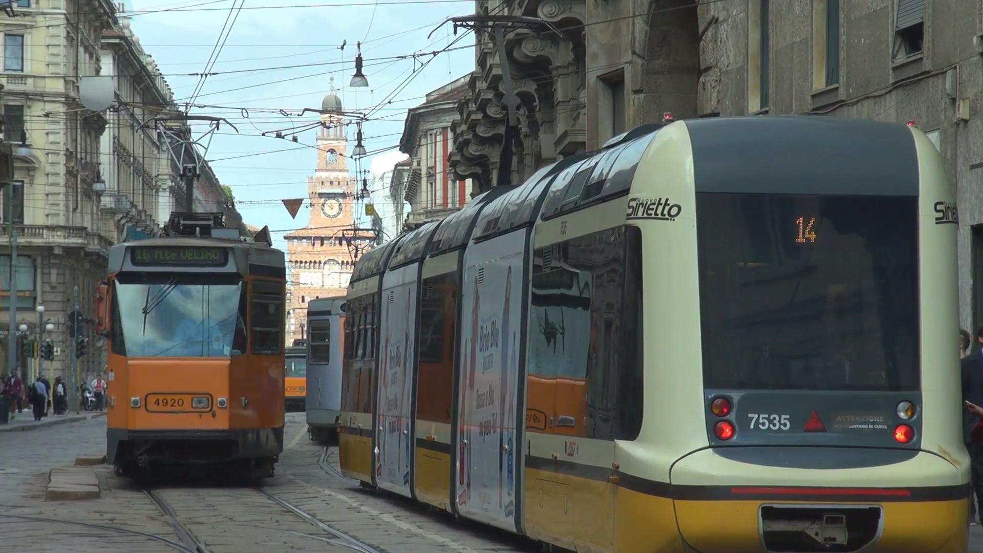 Modern tram traffic old town crowded Milan city people commute ...