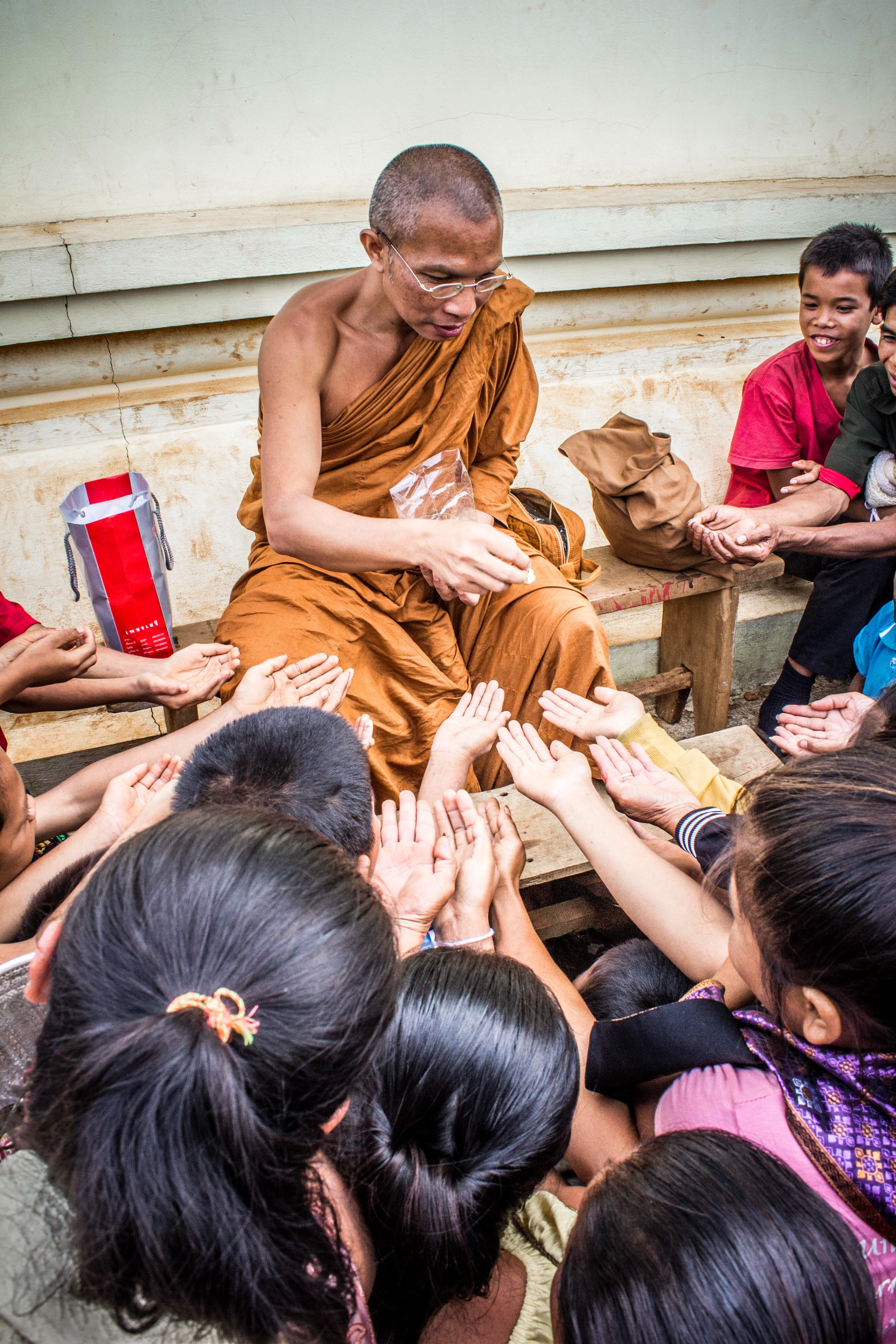 Monk Handing Towards Kids, Adult, Kids, Wooden bench, Wear, HQ Photo