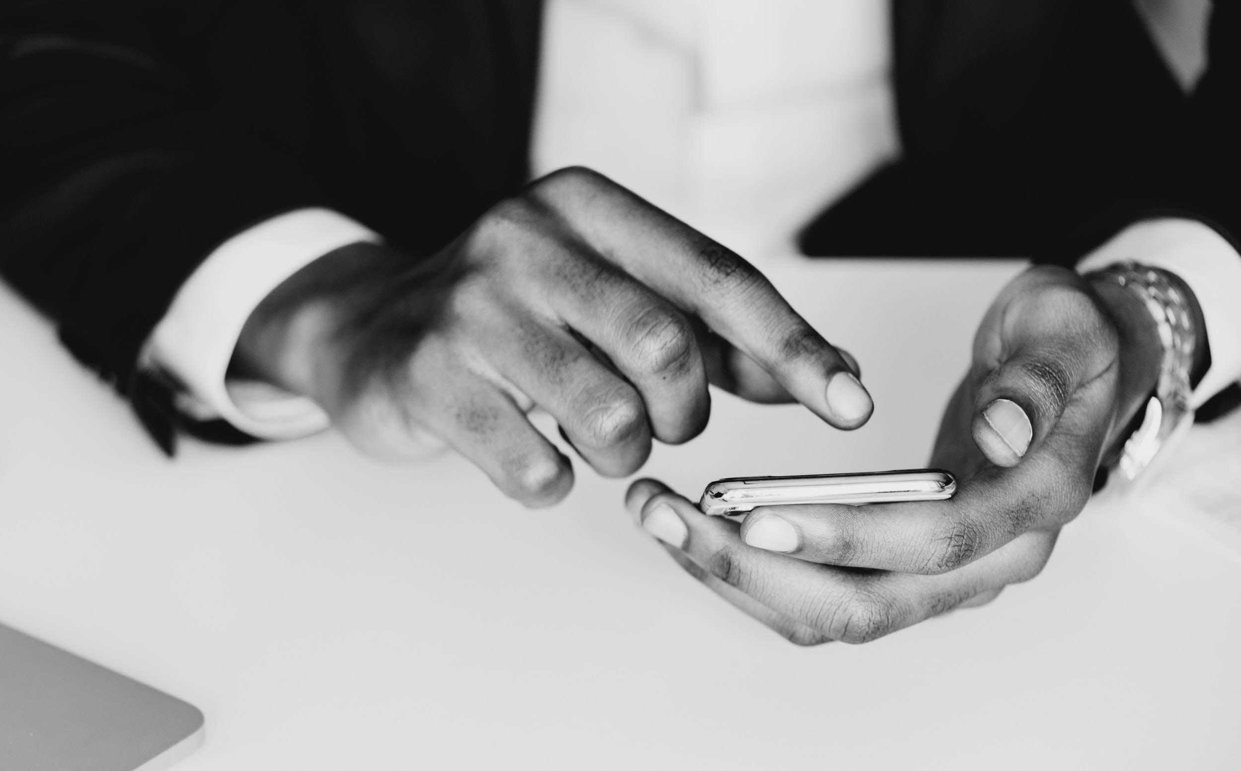 Monochrome photography of a person using mobile phone