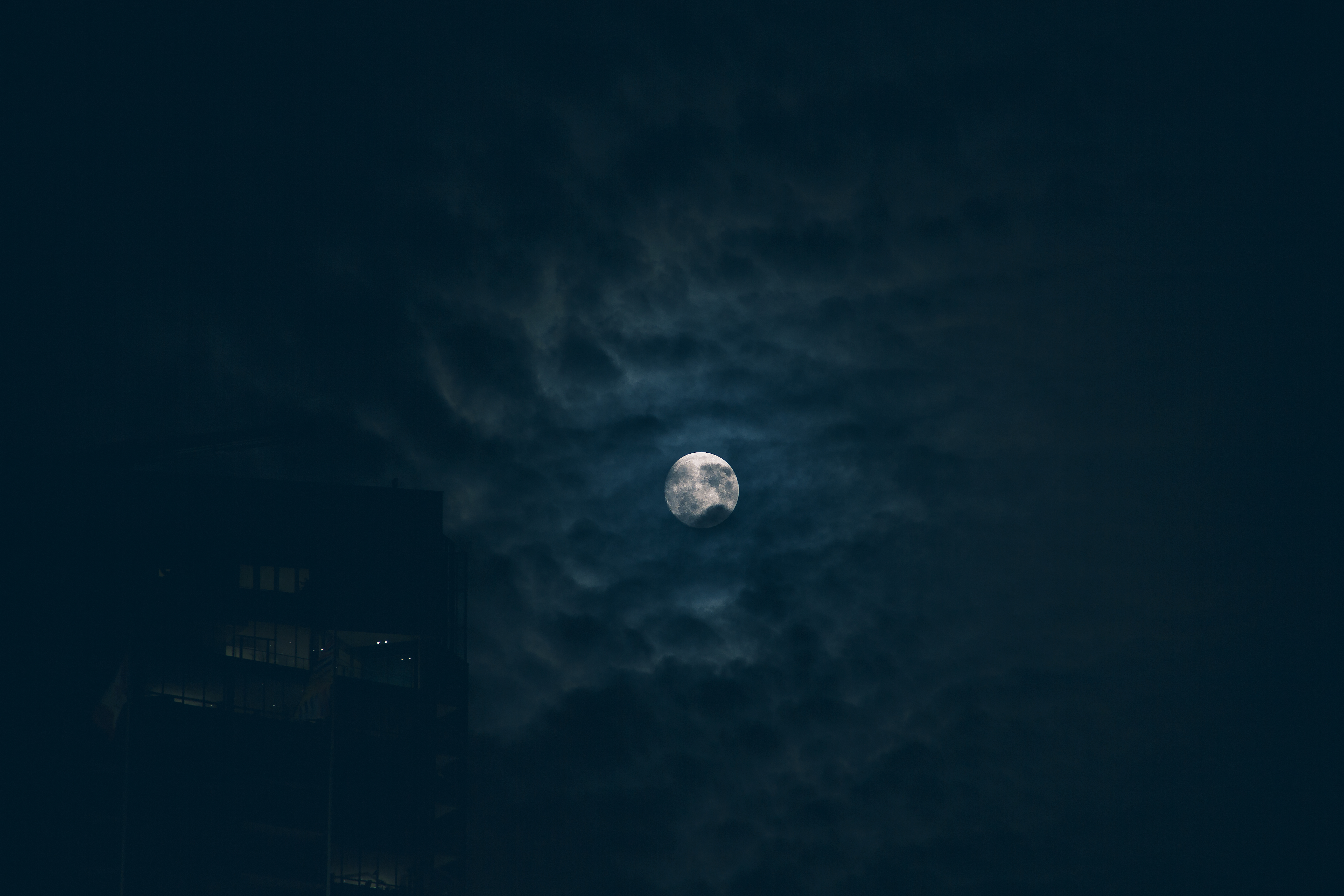 Moon behind clouds photo