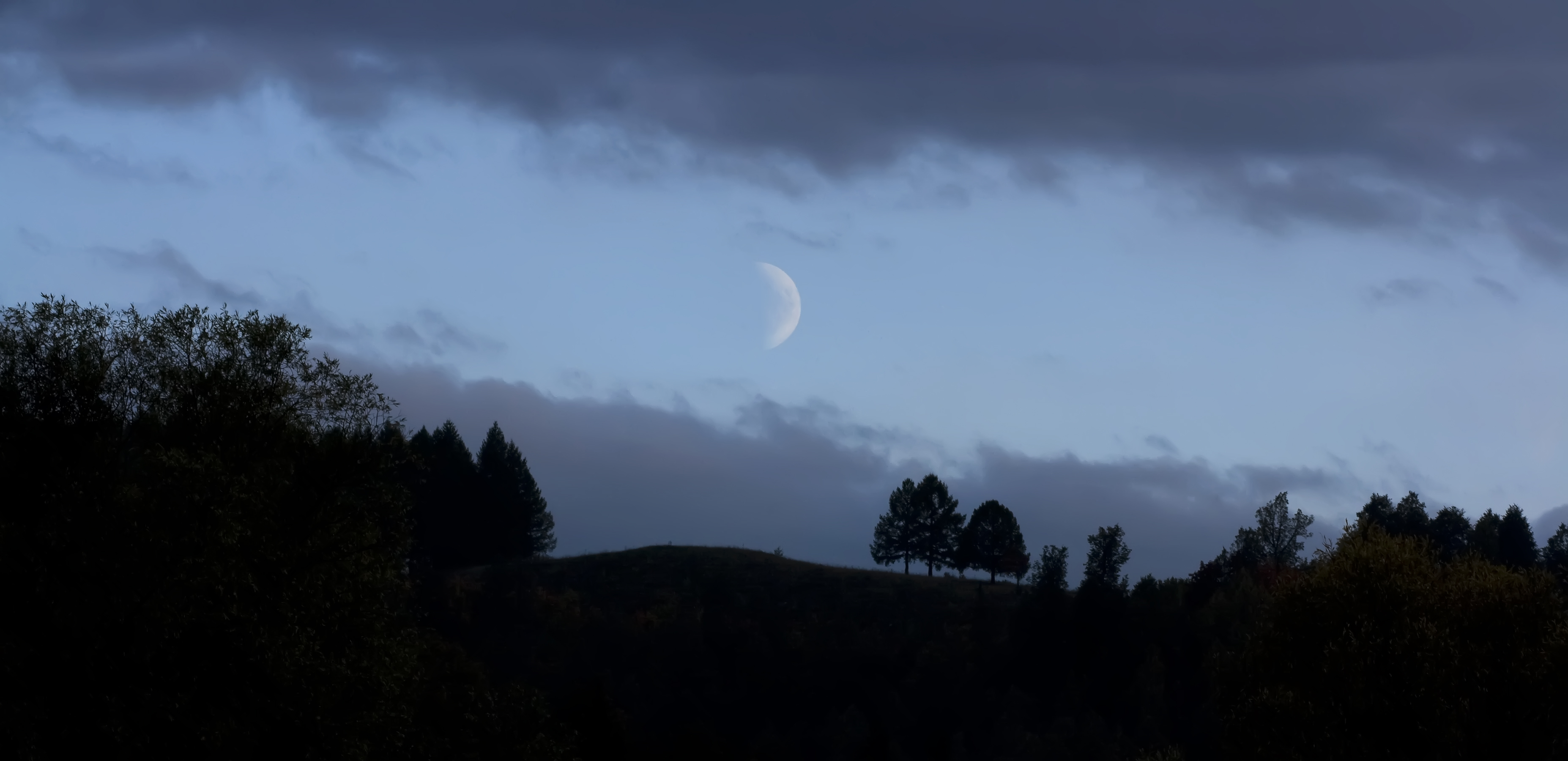 Moon in darkness photo