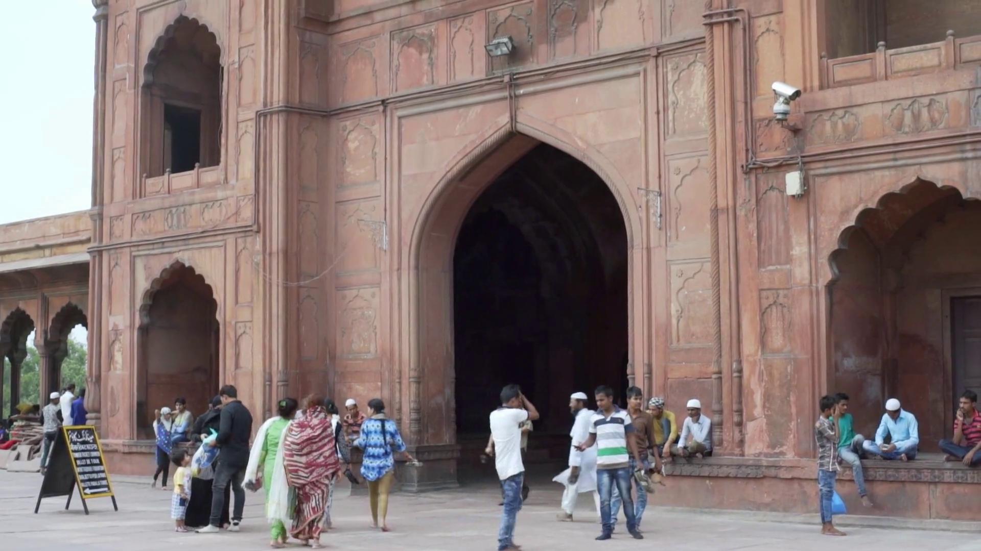People exit Jama Masjid mosque through main gate entrance, New Delhi ...