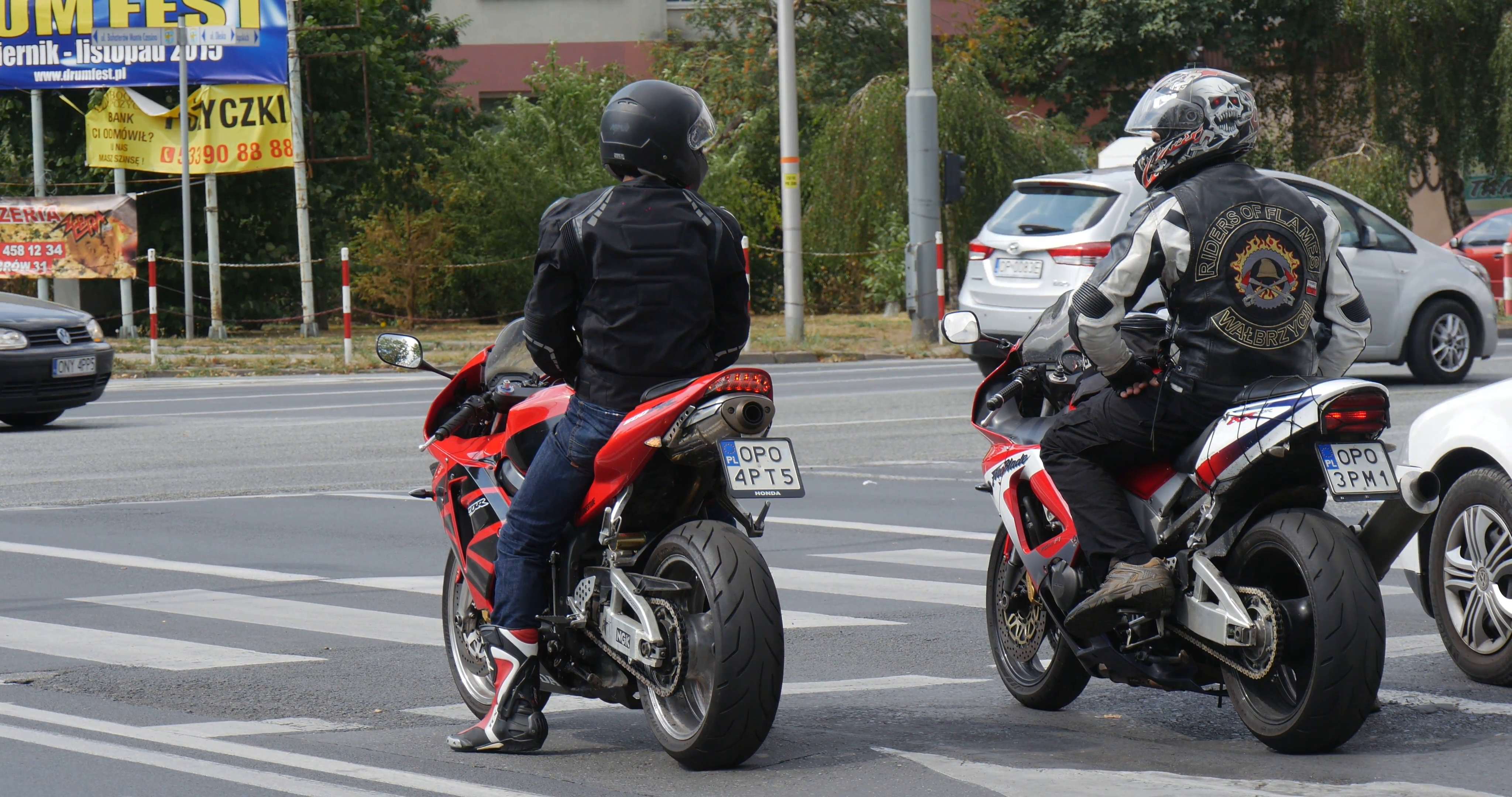 Two Motorcyclists In Motorcycle Helmets On The Sport Bikes Wait At ...