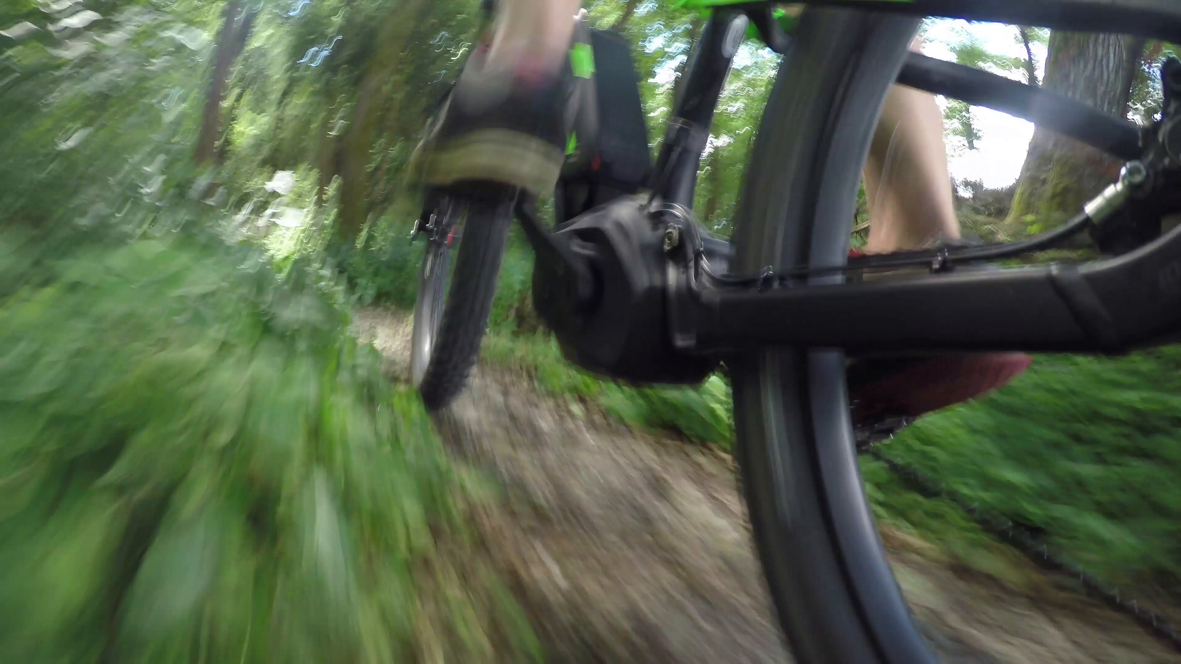 CLOSE UP: Unrecognizable man pedaling electric bike on offroad trail ...