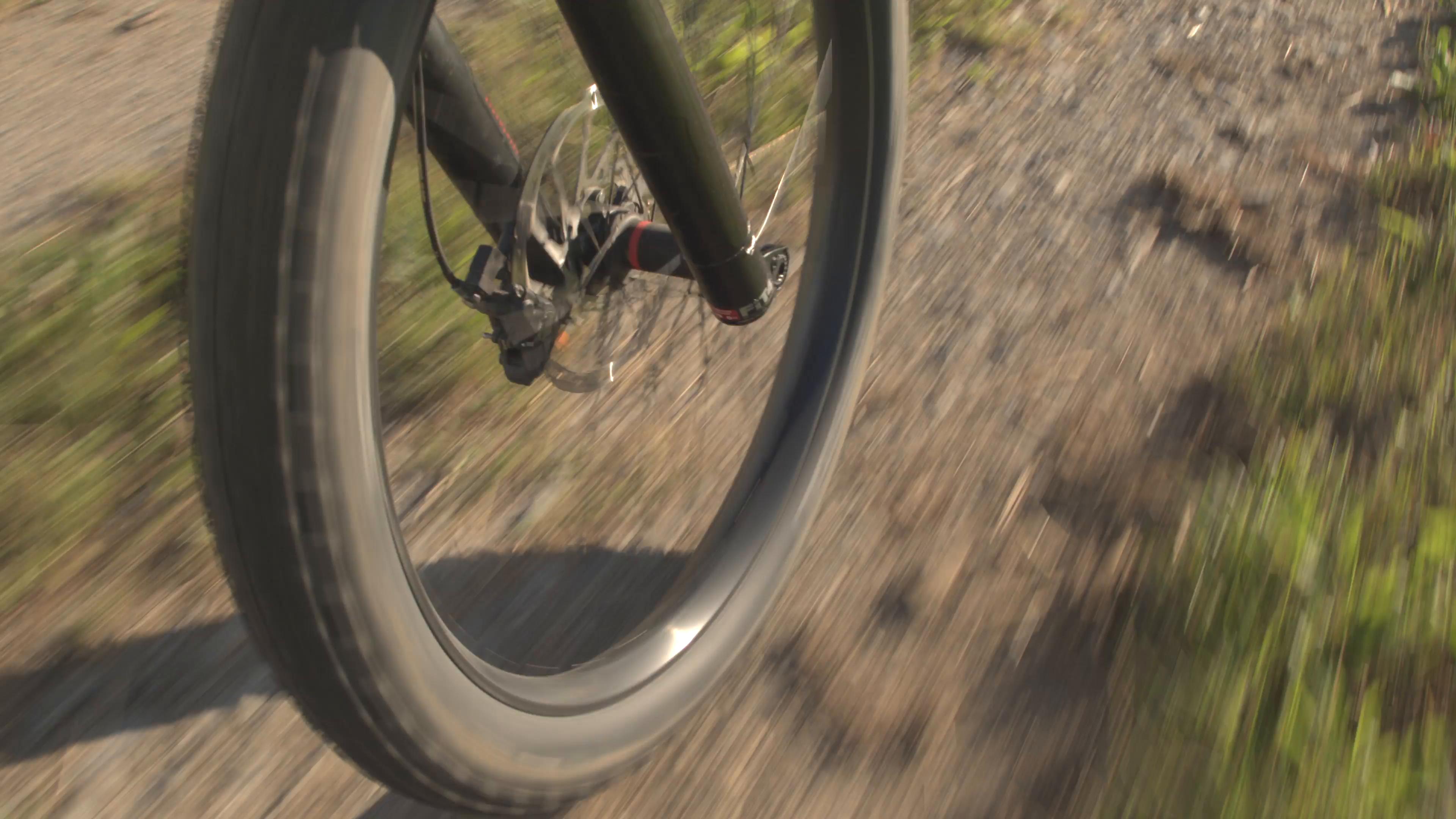 CLOSE UP: E-bike wheel and big mountainbike tire spinning fast on ...