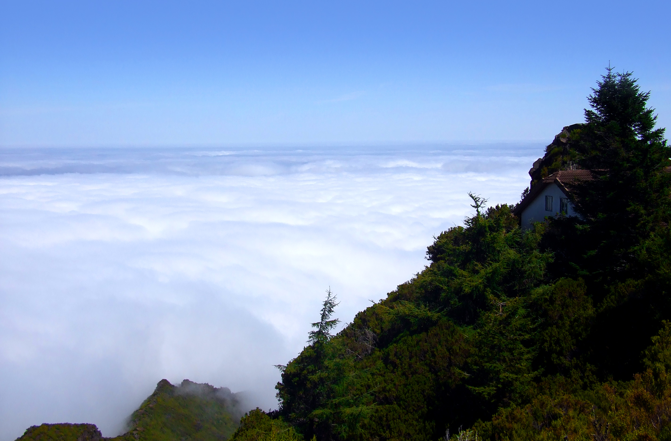 Mountain cabin above the clouds photo