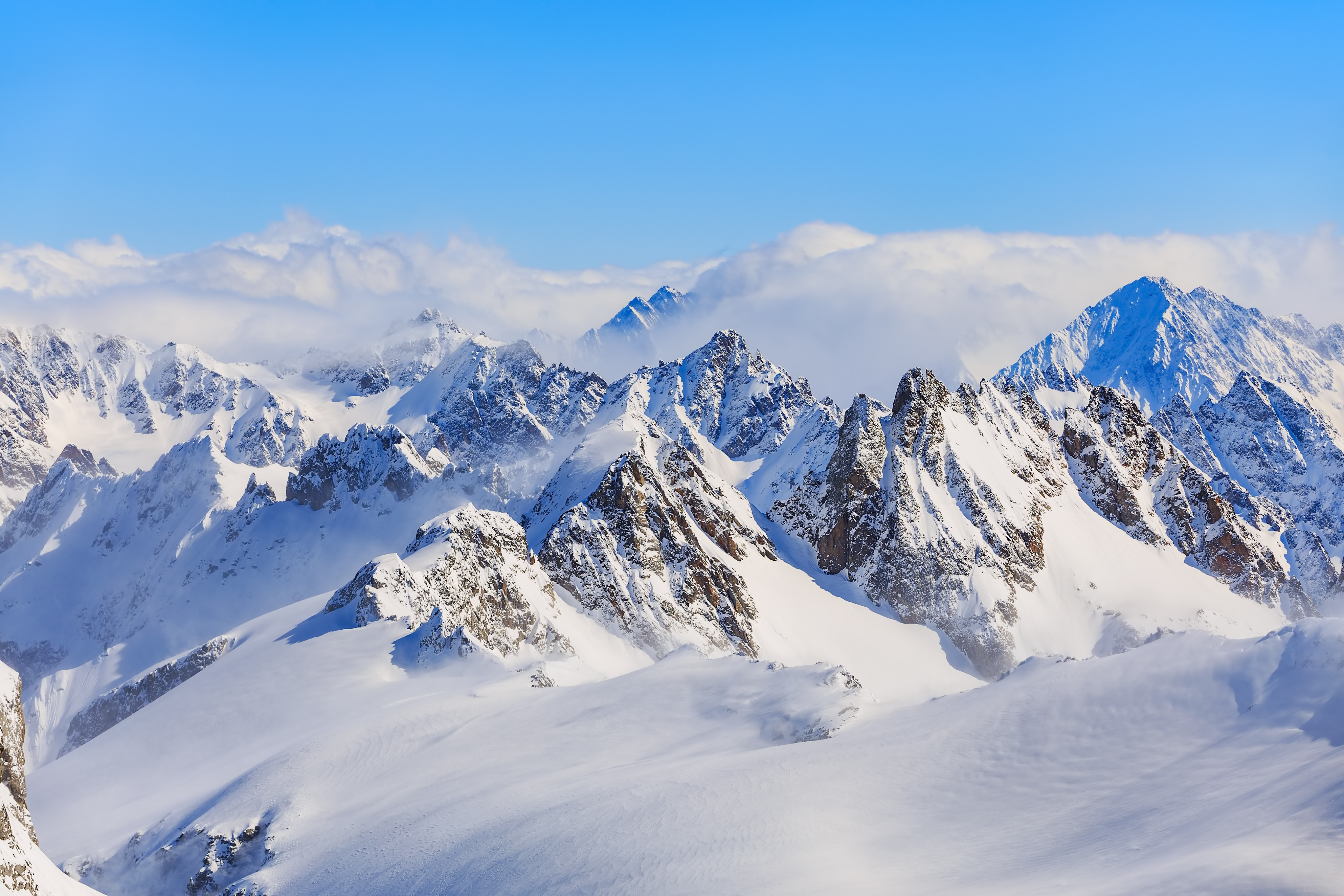 Mountain ranges covered in snow photo