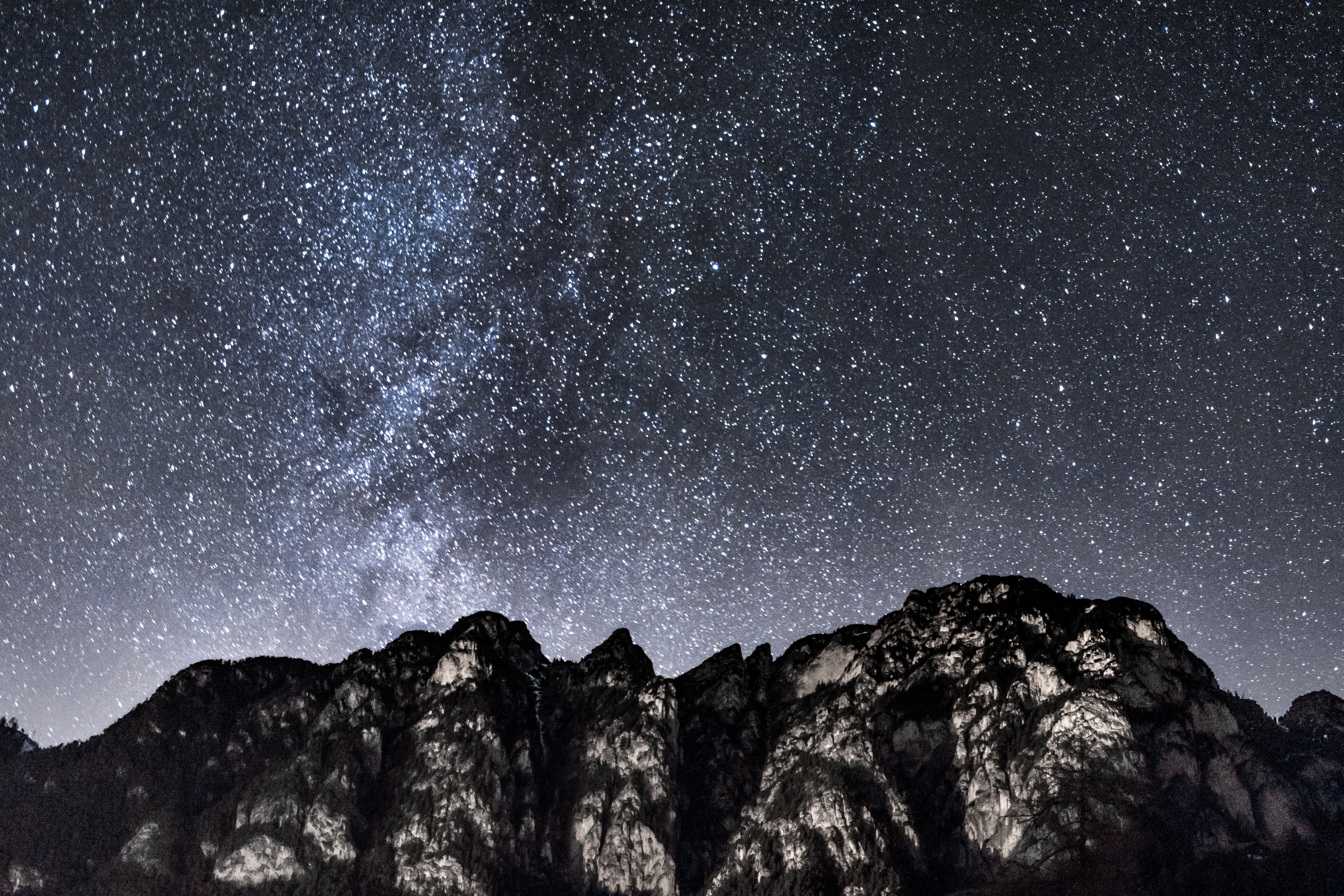 Mountain under starry sky during nighttime photo