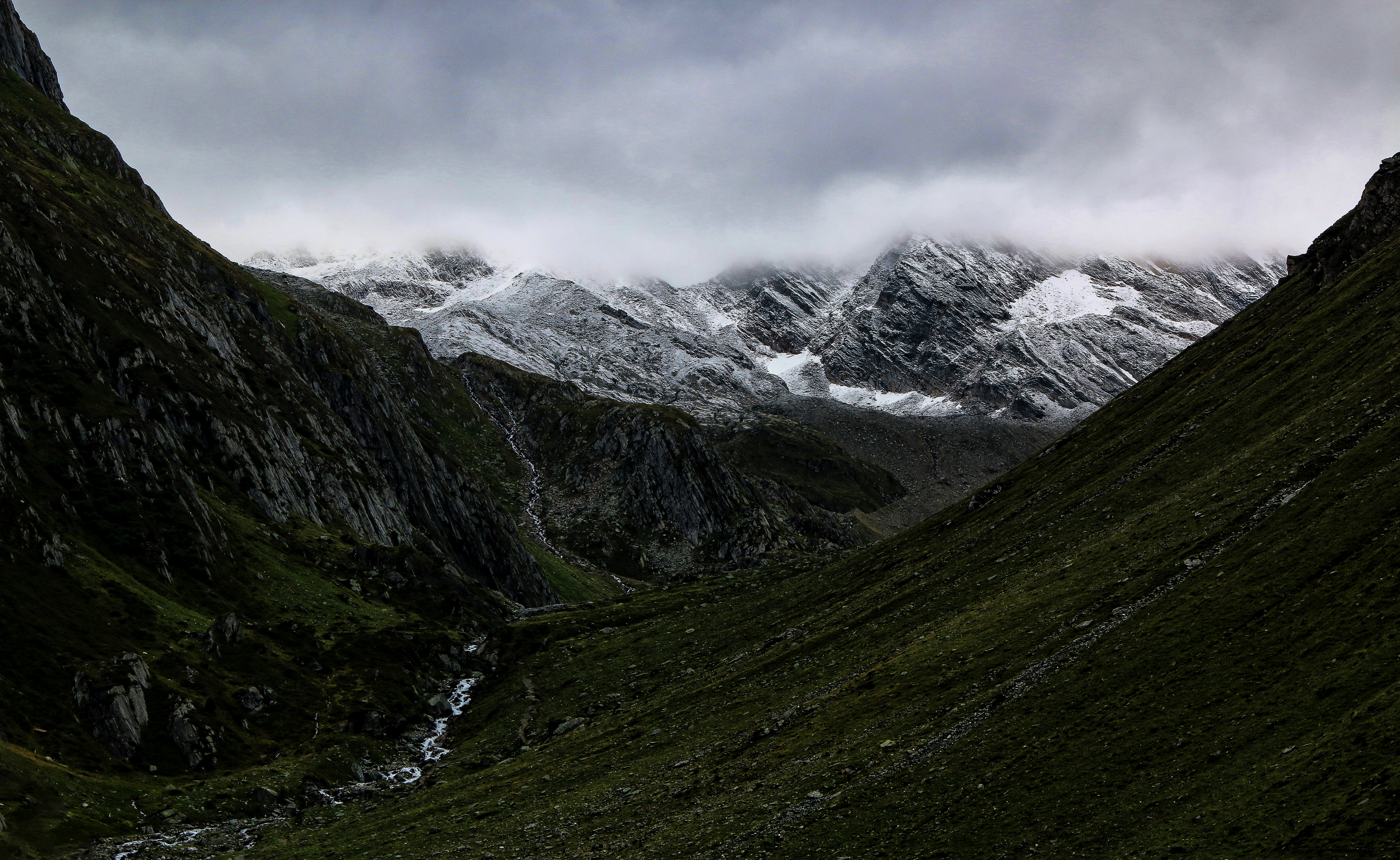 Mountain valley under cloudy sky photo