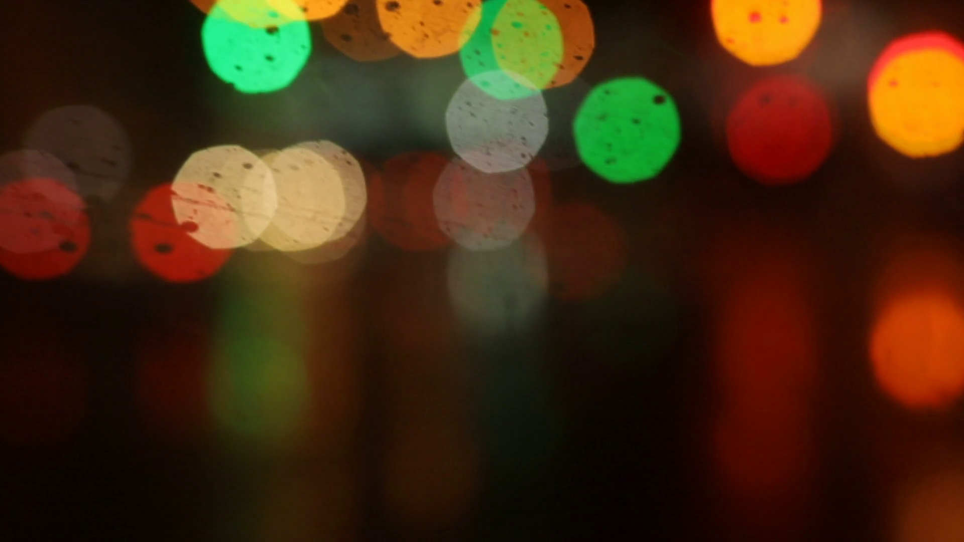 Multicolored bokeh from street and traffic lights at night. Car ...