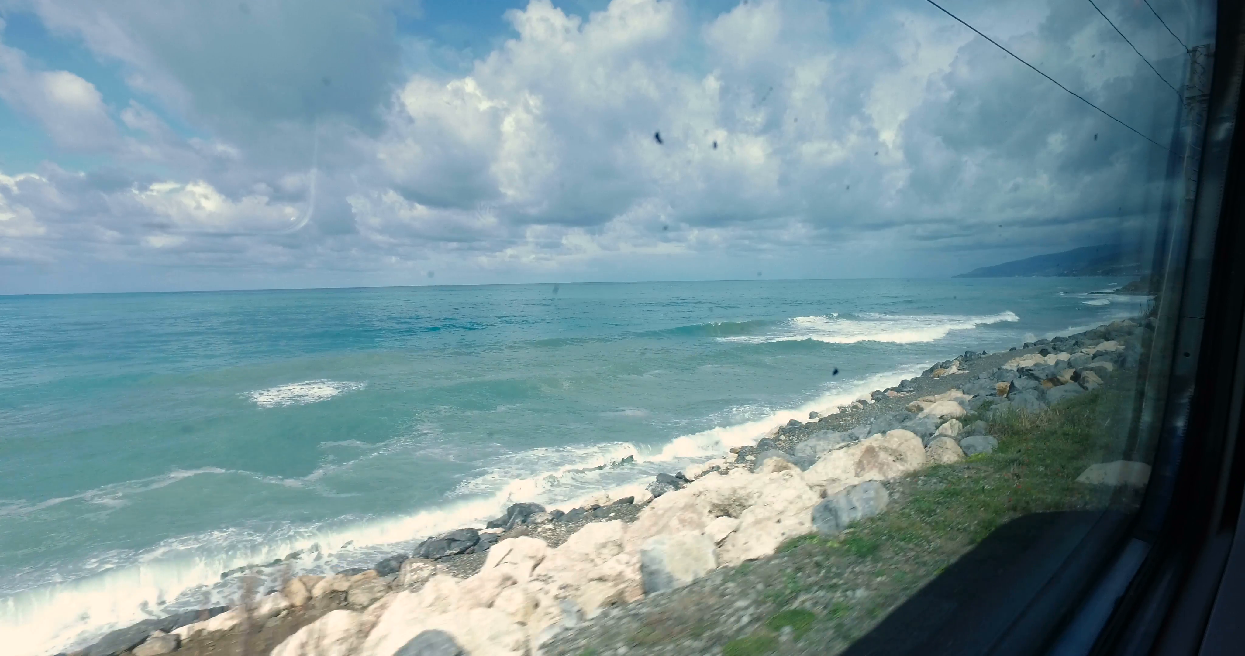Traveling Very Close to the Beach near the Ocean from a Window of ...