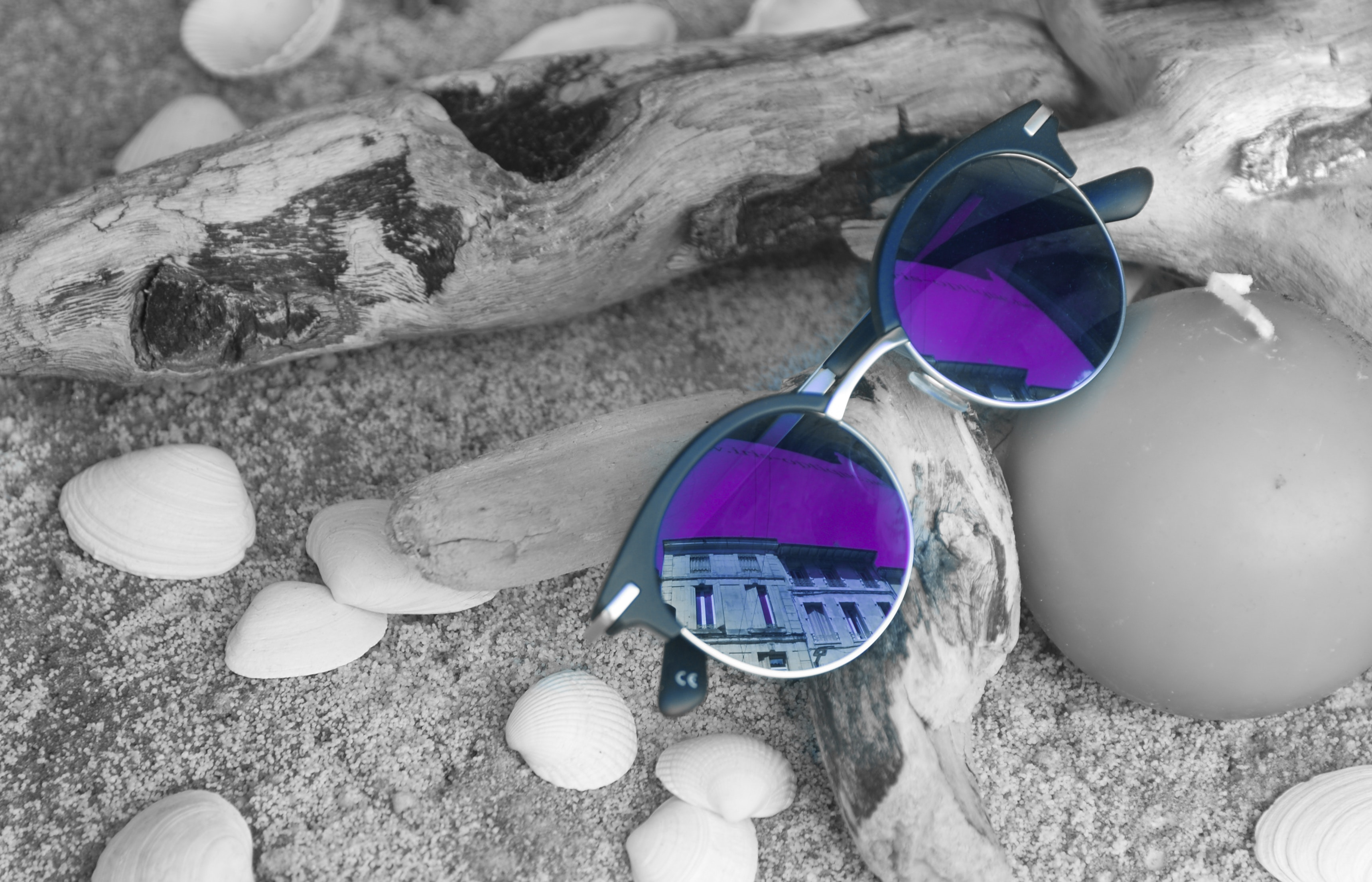 Neo chrome sunglasses with silver and black frame on brown firewood photo
