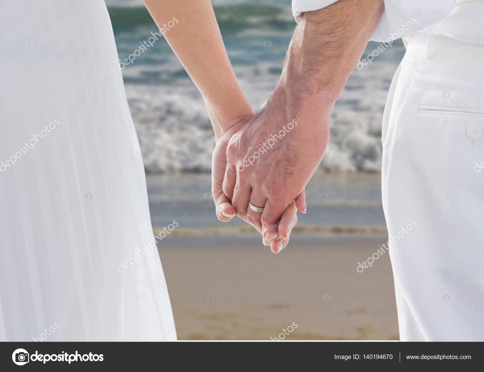 Newlyweds holding hands photo