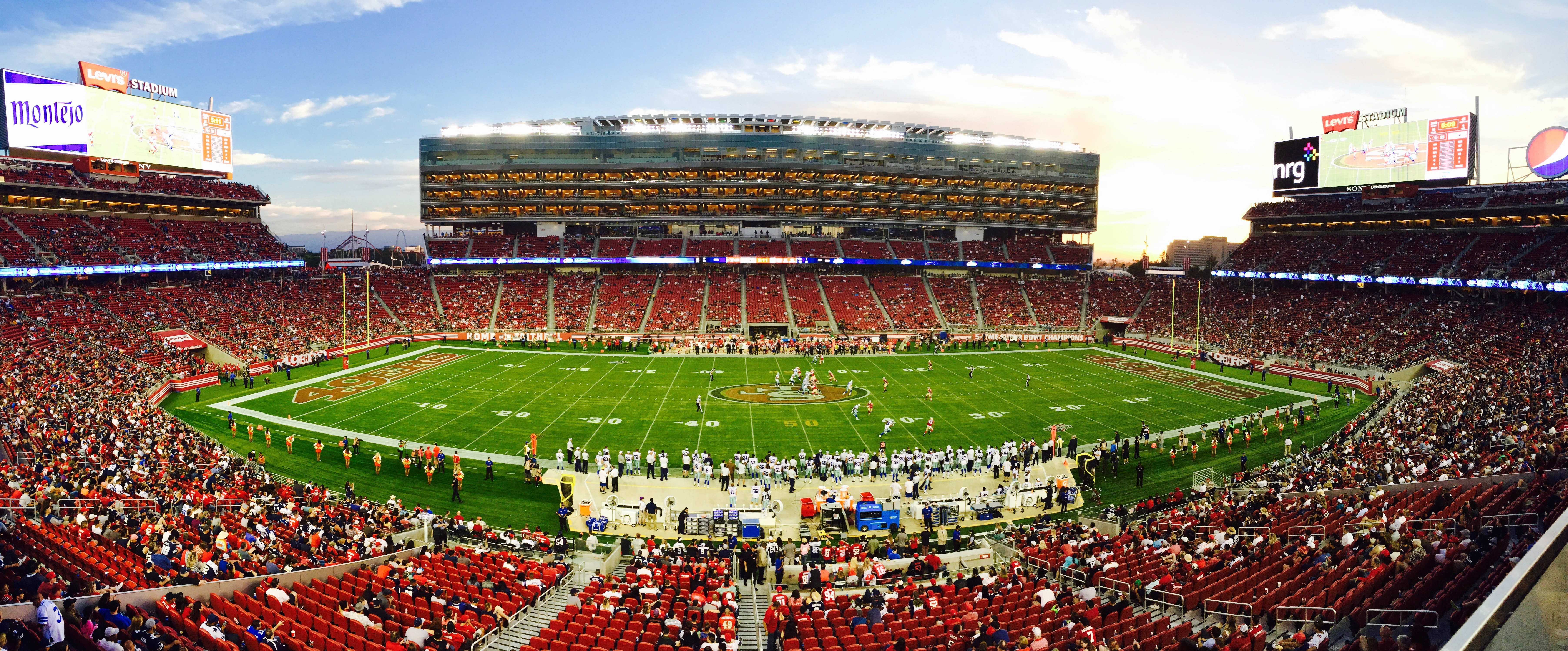 Nfl stadium field full with crowd watching the game during daytime photo