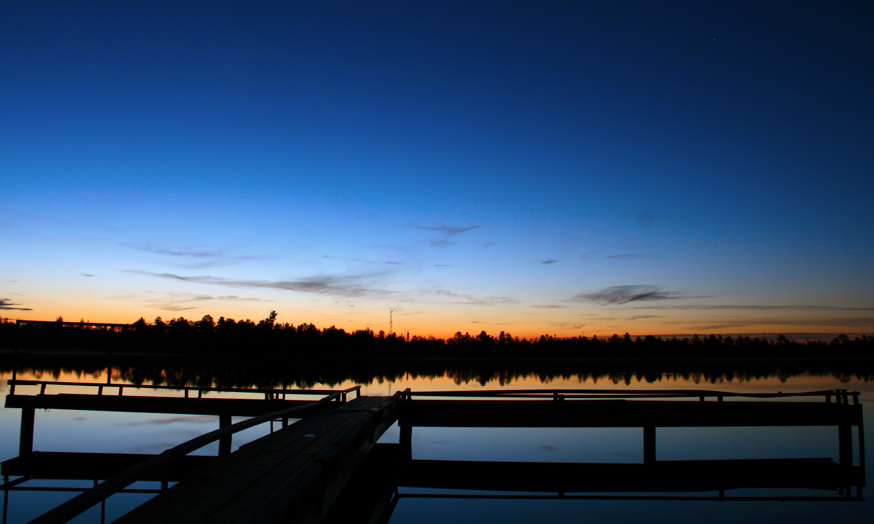 Night scenery over lake and pier photo