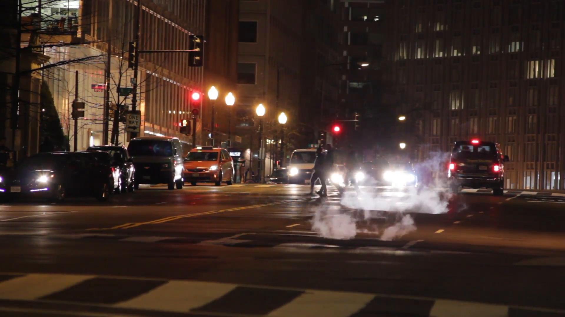 Street scene in Washington DC at night. Traffic and Pedestrians. (7 ...