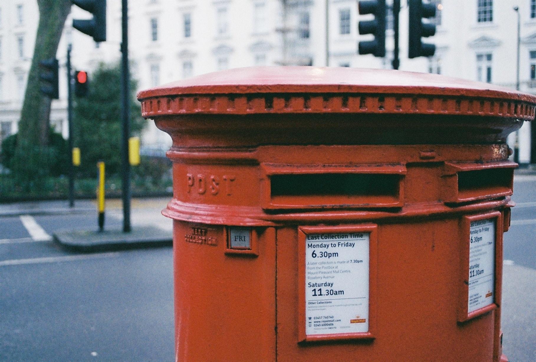 Oblong brown metal mailbox photo