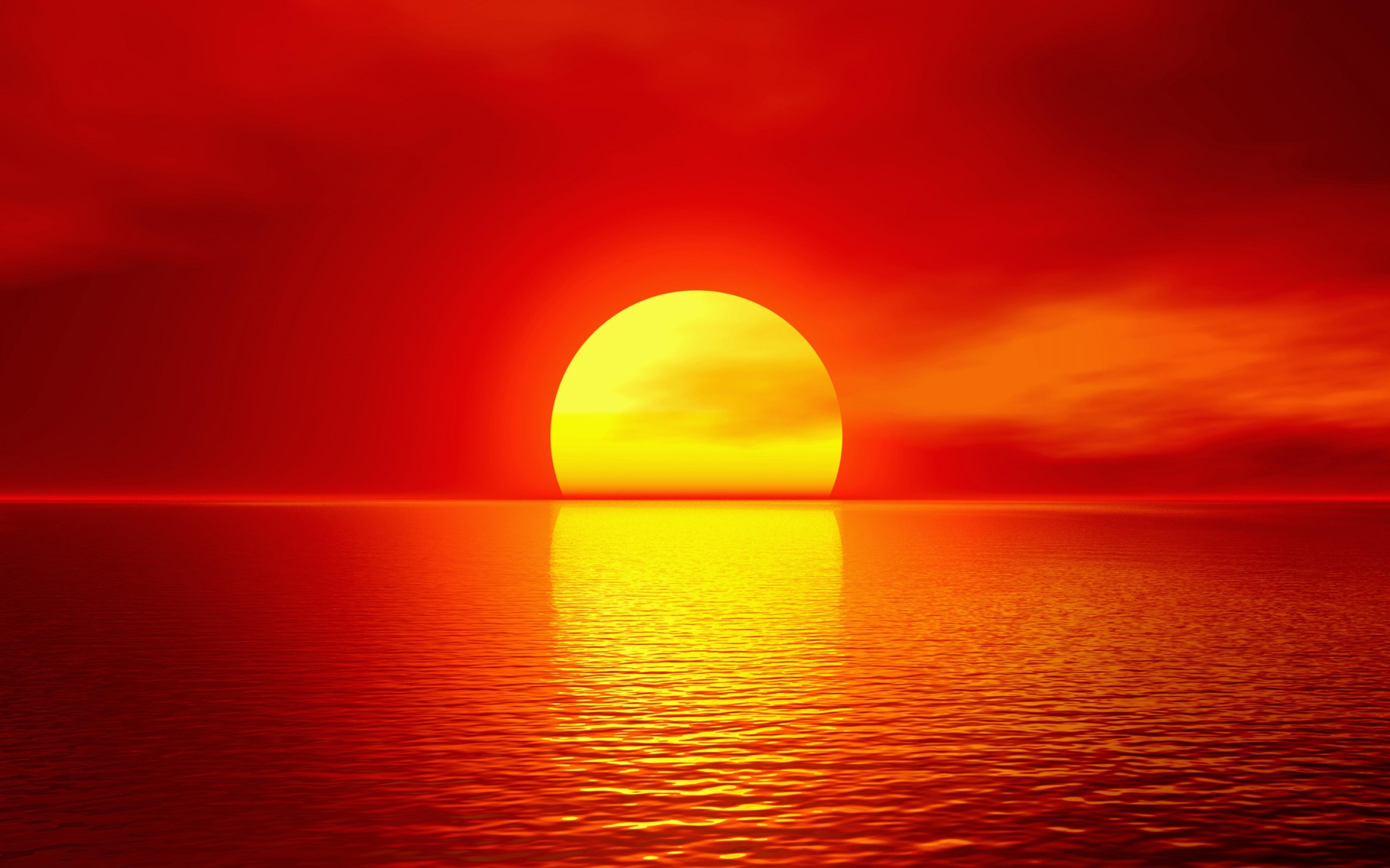 Big golden ball - summer sunset over the ocean
