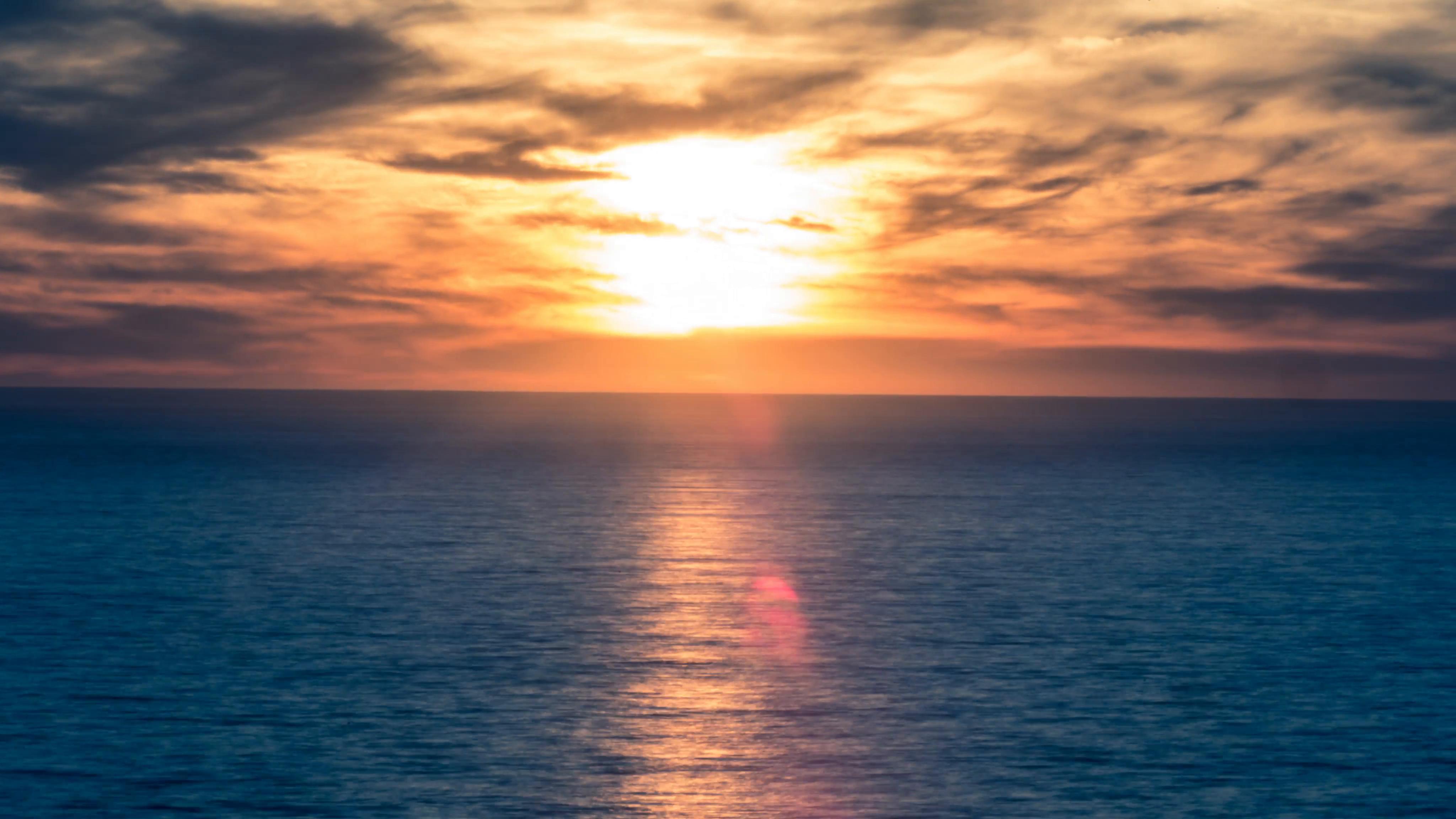 Sunset over Blue Ocean - Timelapse Sun Setting Orange Sky 4K Time ...