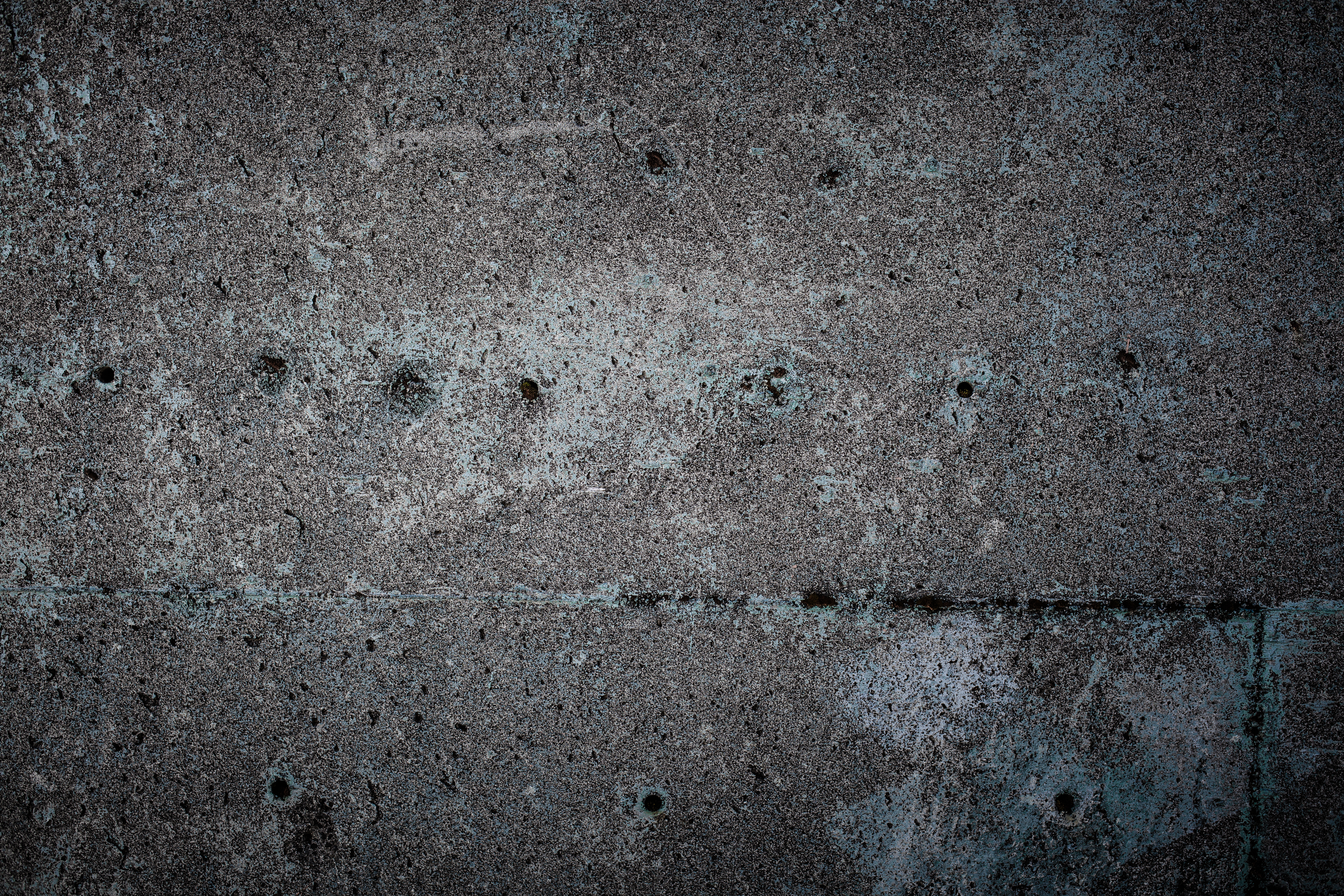 Old blue concrete with holes photo