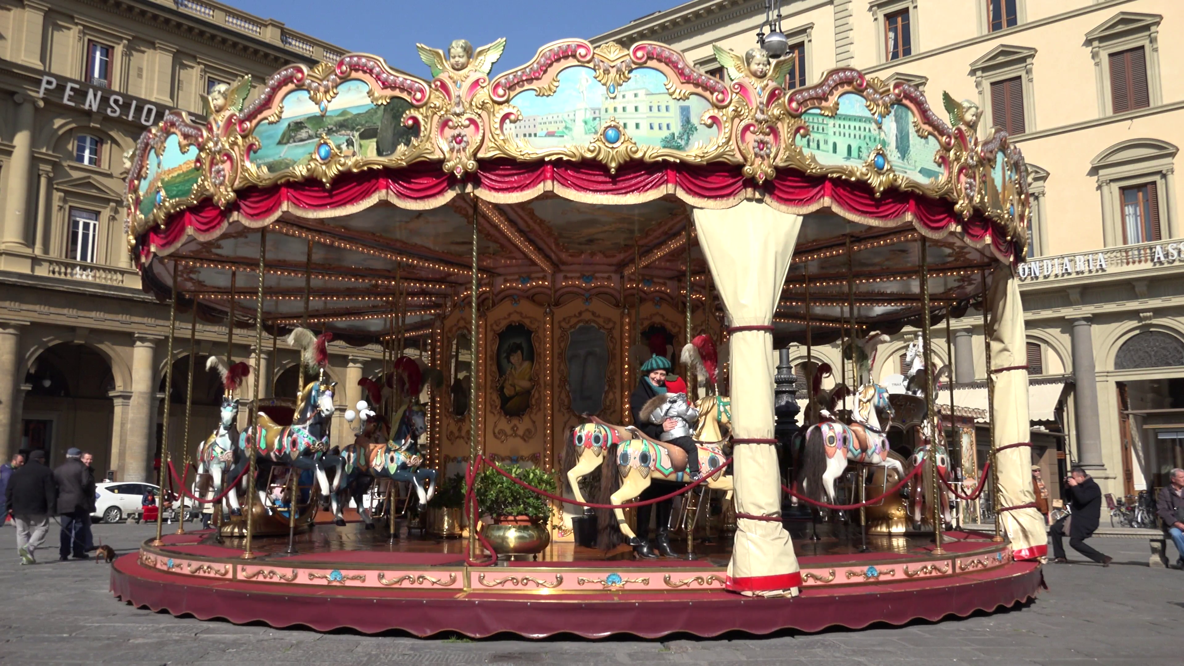 ULTRA HD 4K Merry go round spinning Florence old town carousel ...
