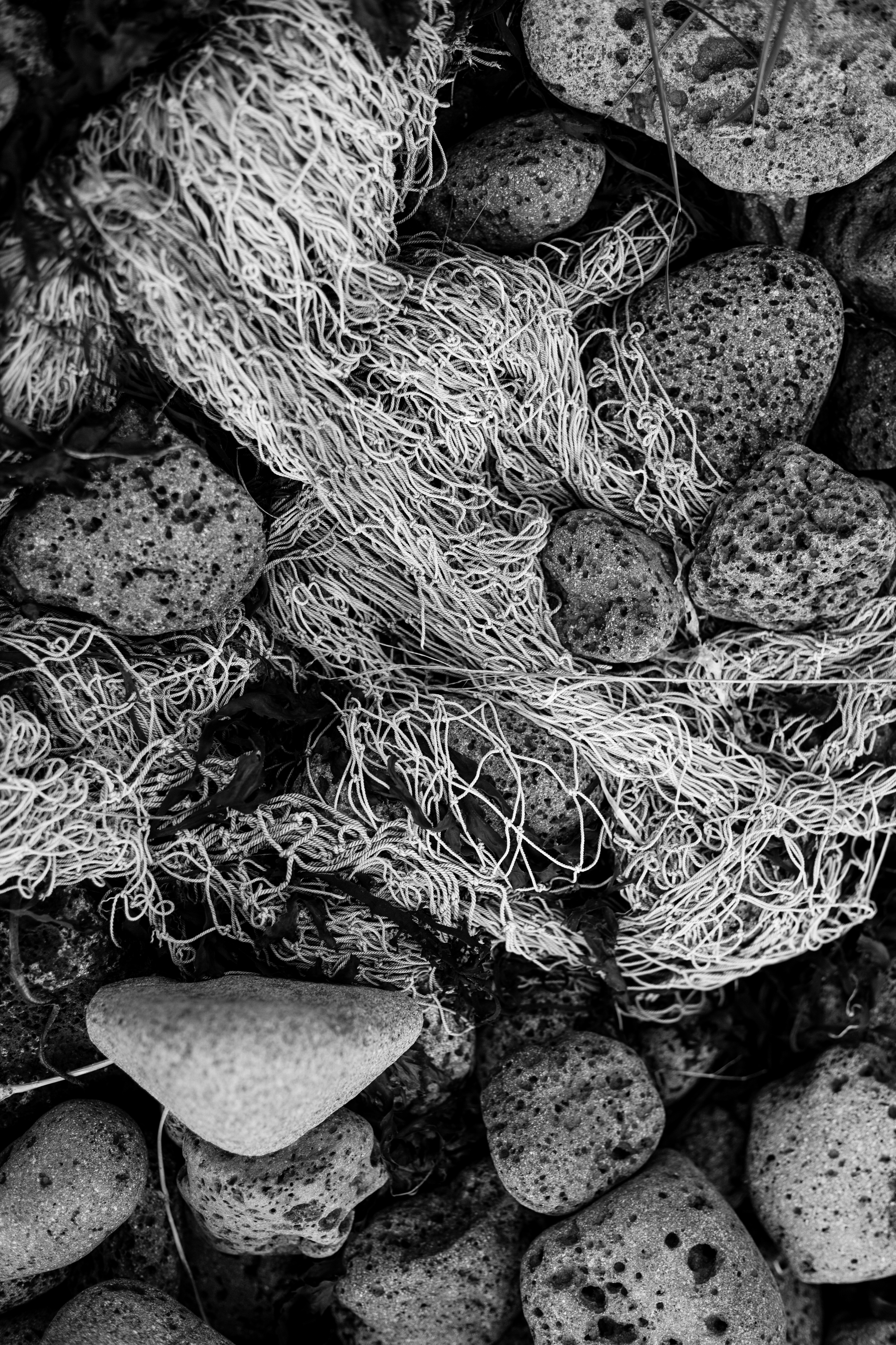 Old fishing nets and rocks photo