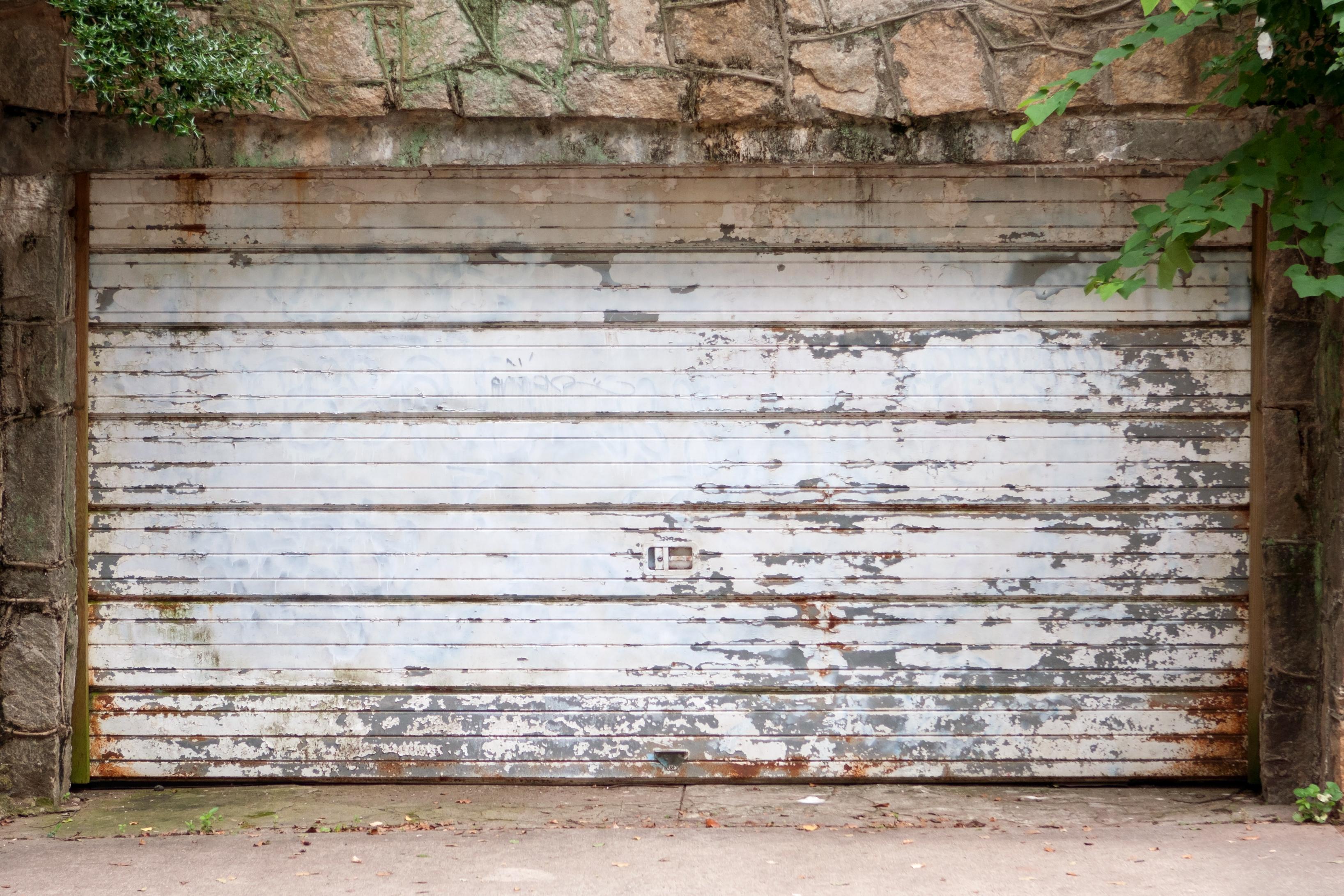 Repair vs. Replacement: Options for Old Garage Doors