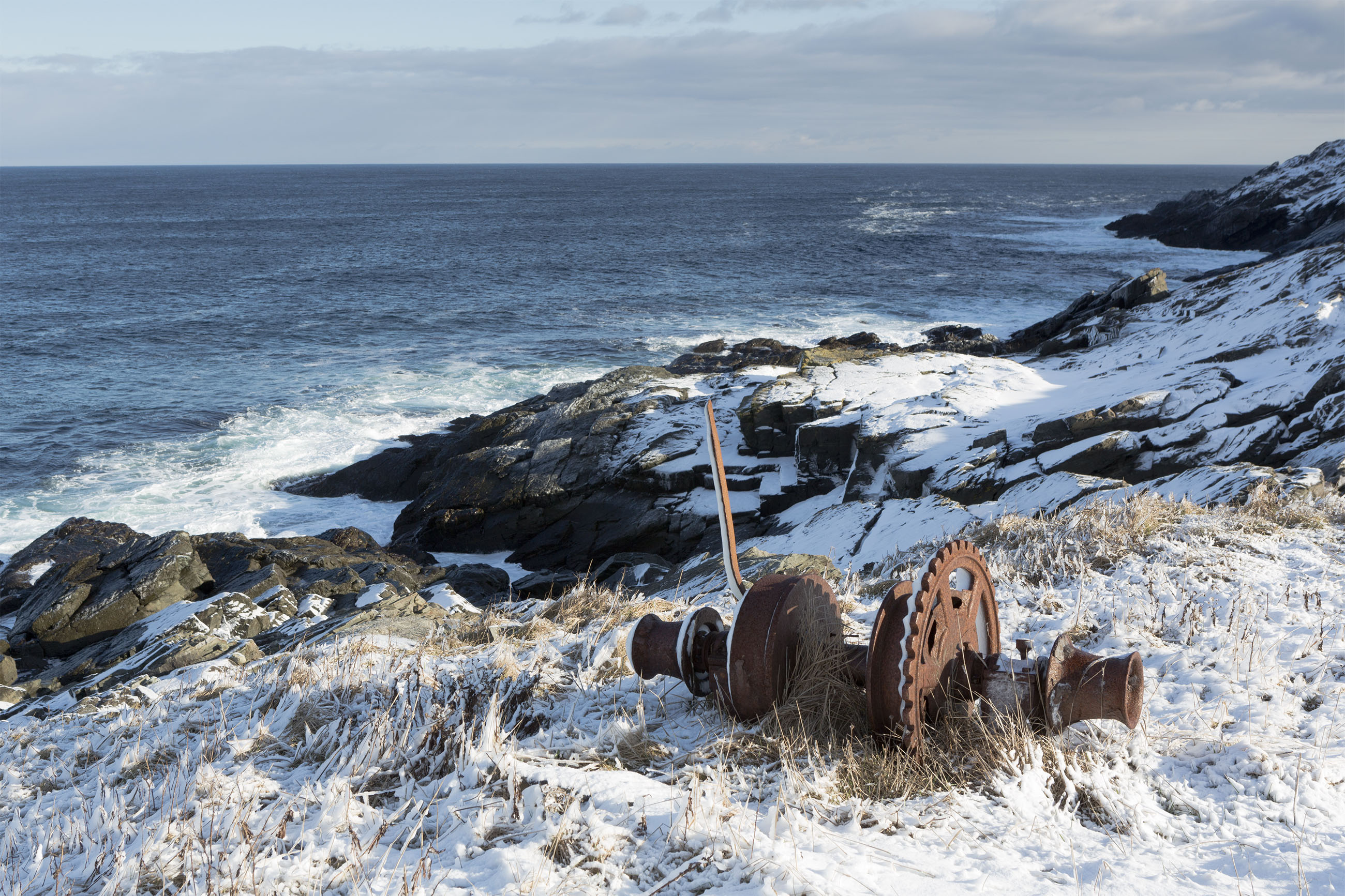 Old gears and winter seascape photo