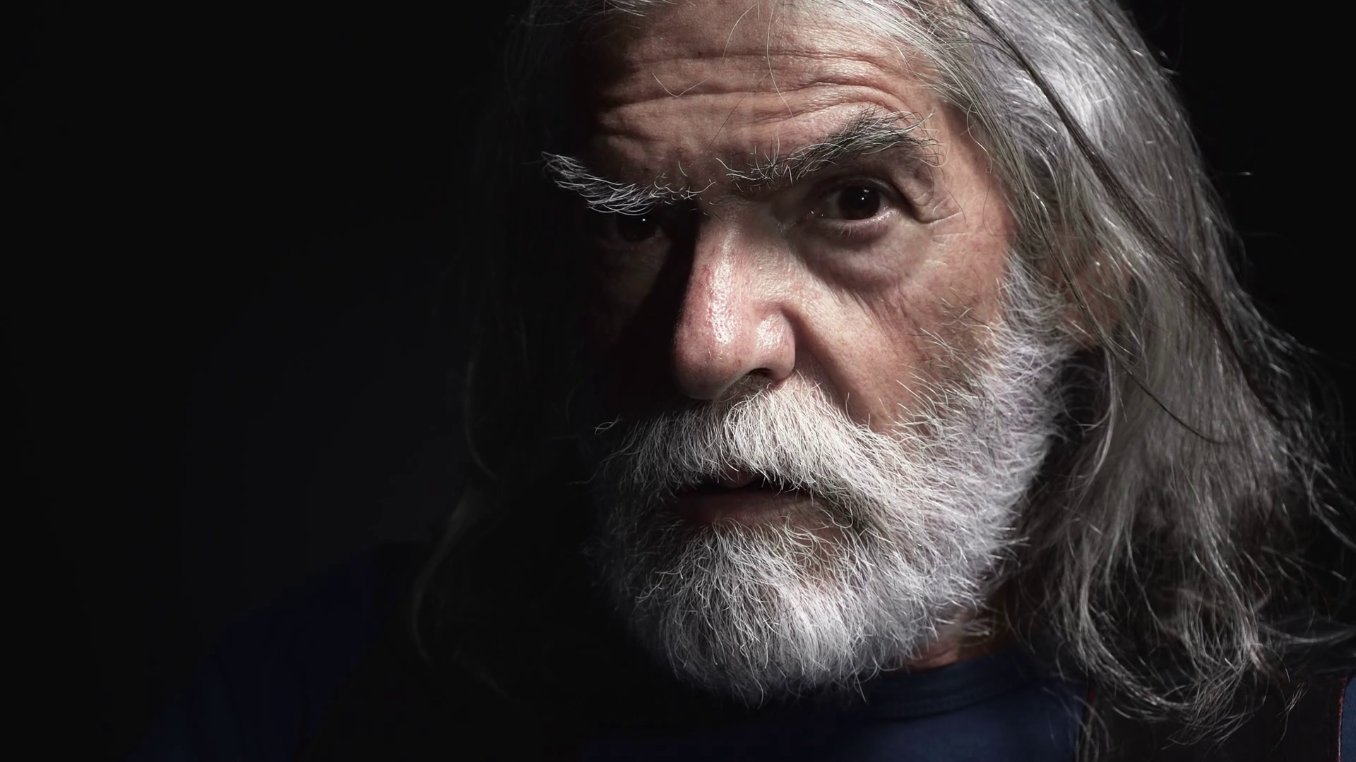 angry serious old man with long white beard looks threatening the ...