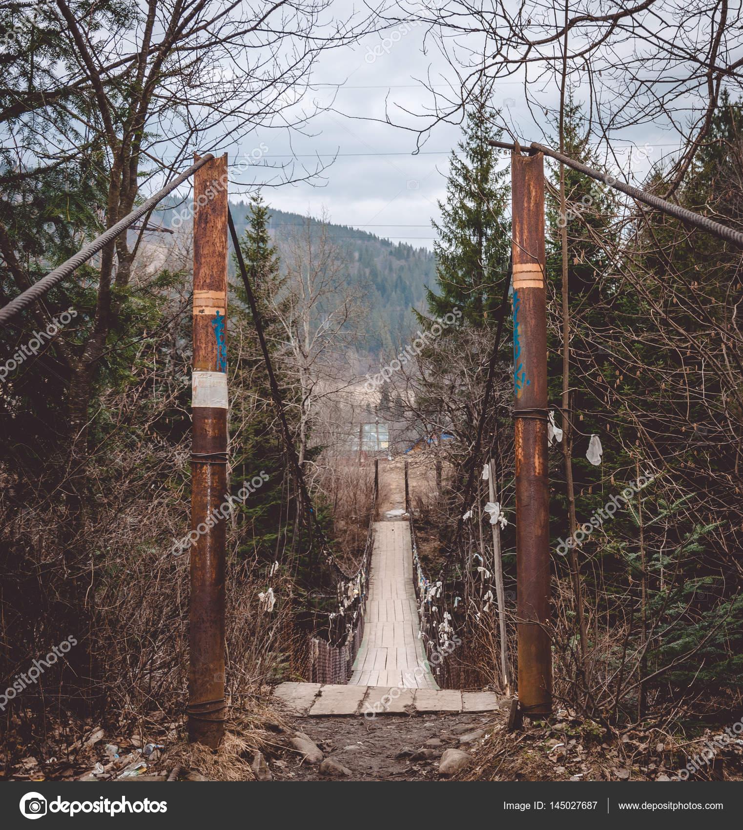 Old suspension bridge in Eastern Europe — Stock Photo © konoplizkaya ...