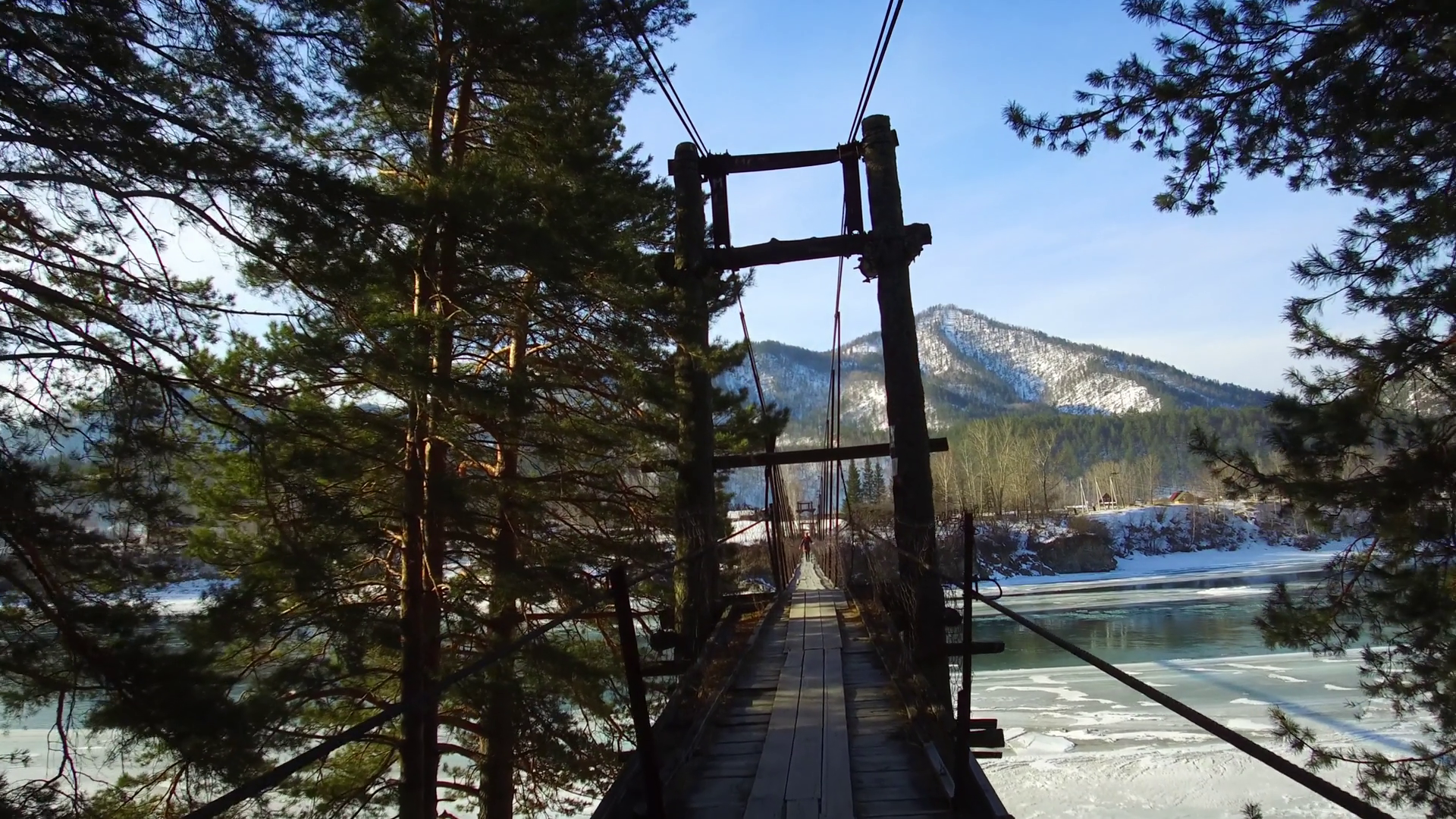 Motion video of walking through old shaky suspension bridge over ...