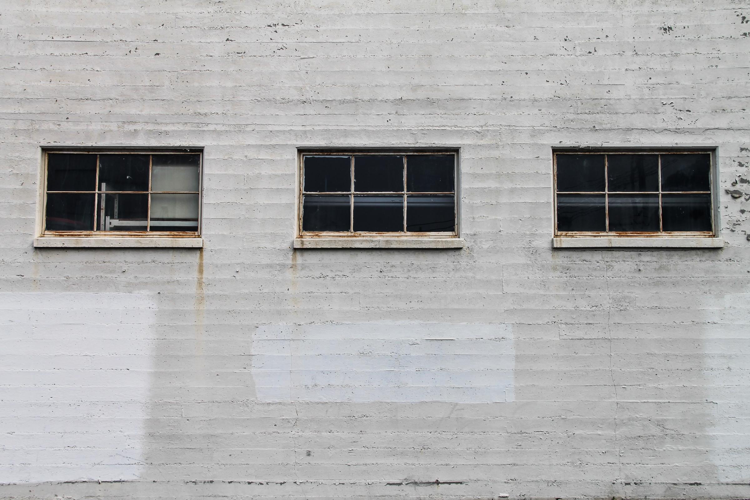 Free Stock Photo of 3 Windows on White Brick Building