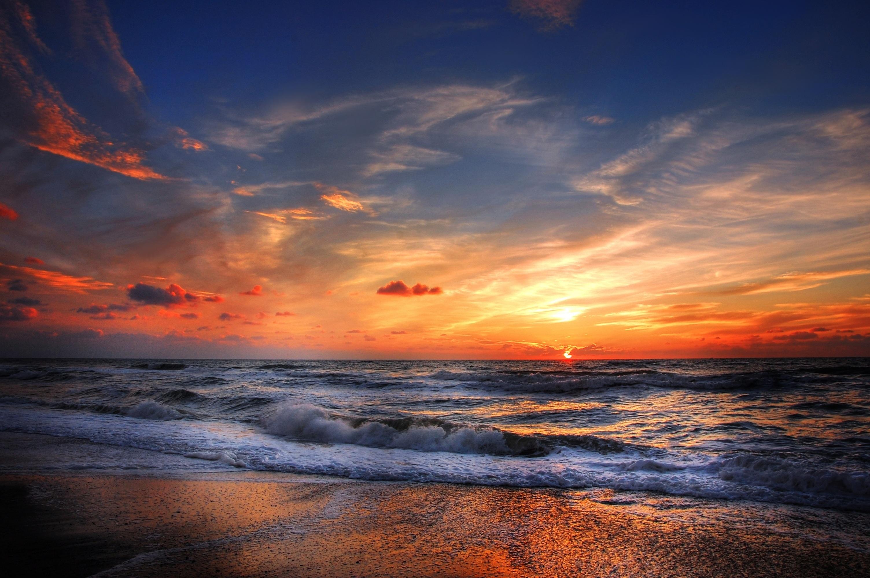 On the beach at sunset photo