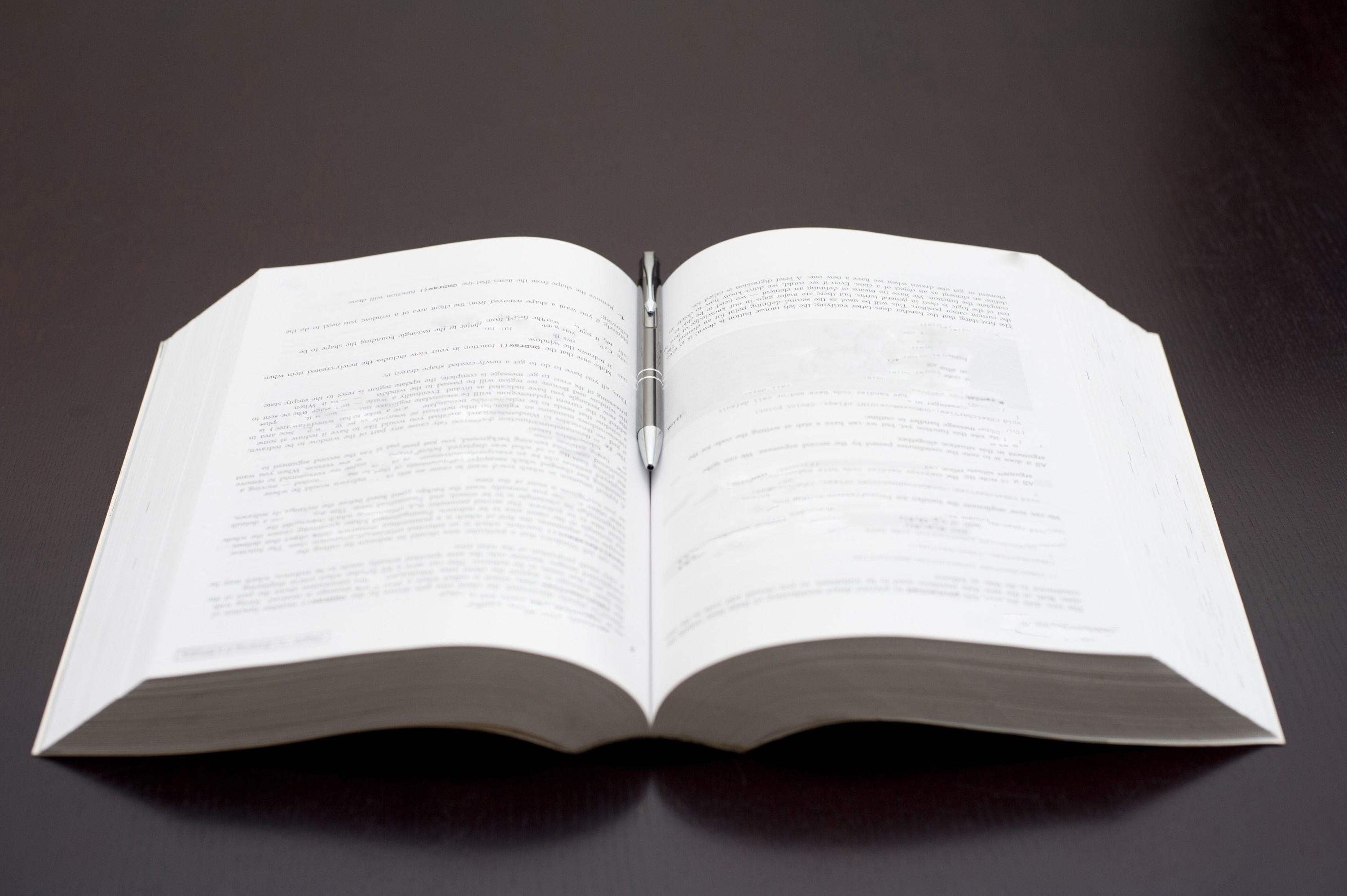 Free image of Open book and pen