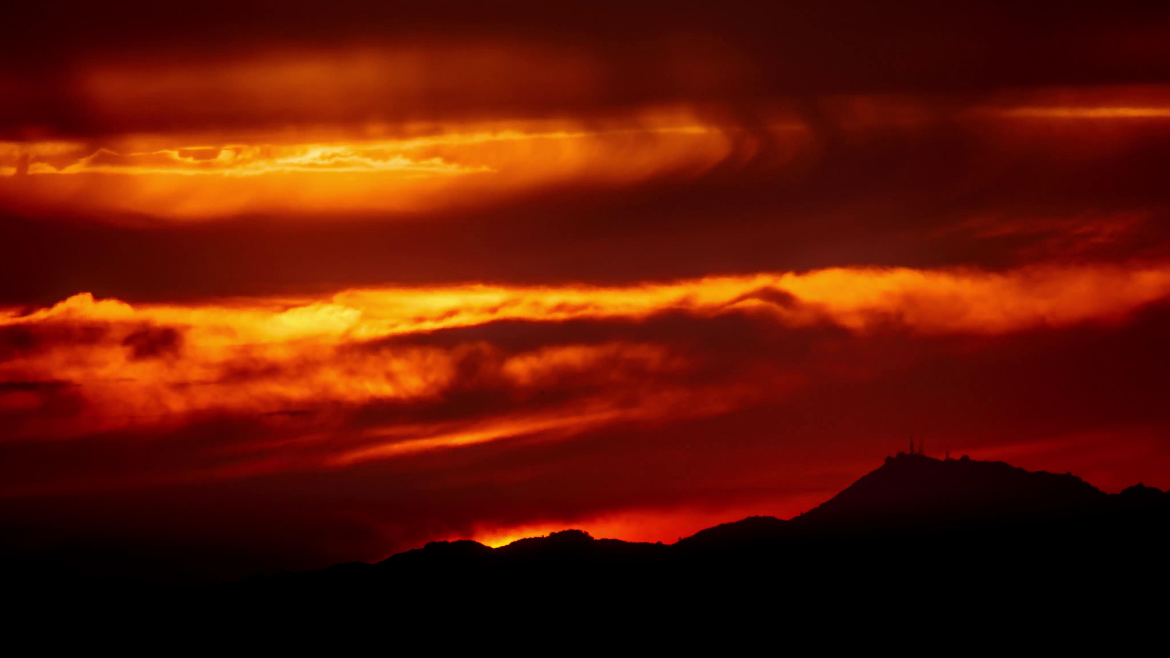 4K. Beautiful scenic dramatic fiery orange sunset sky background ...