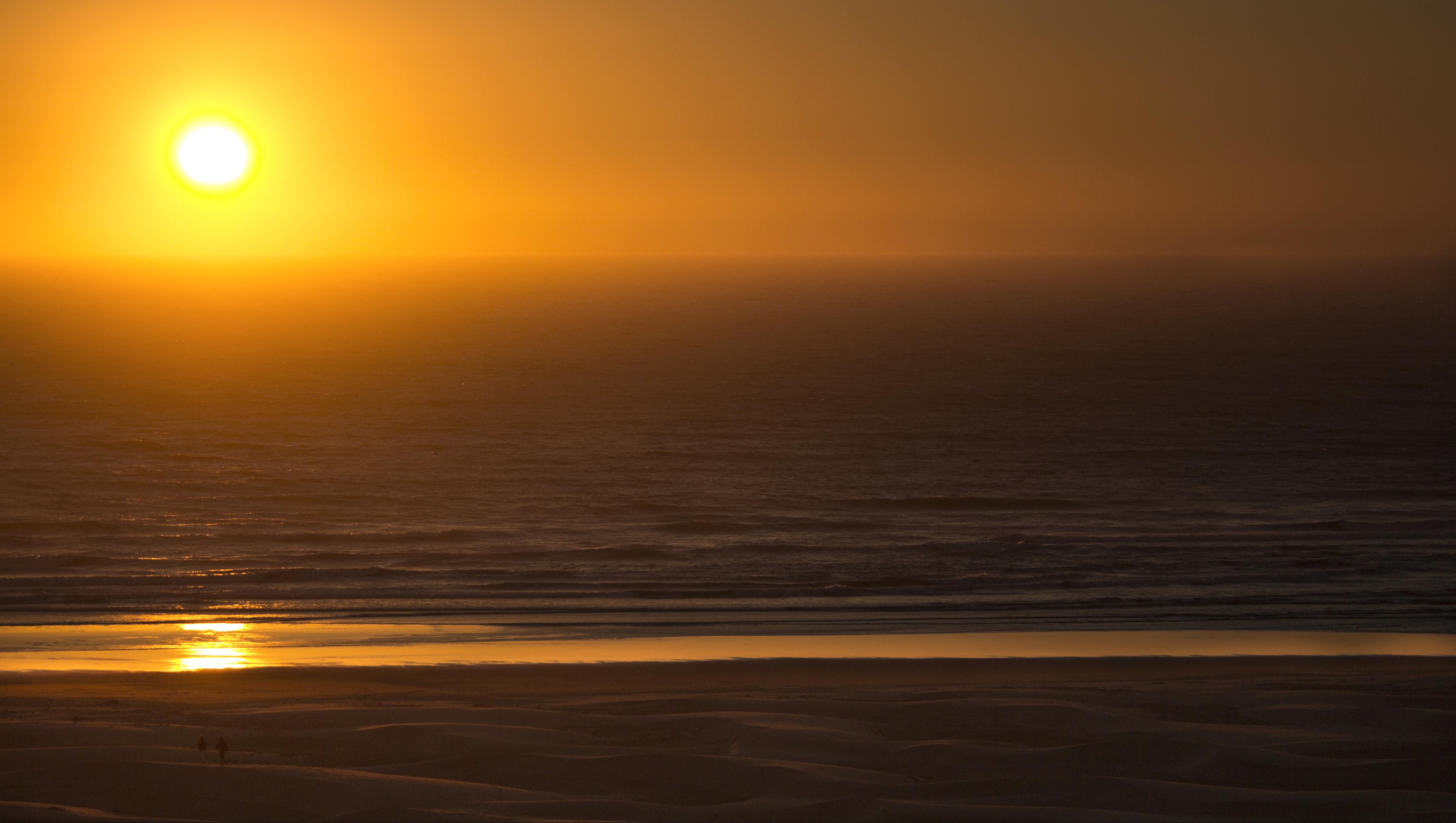 Orange sunset at the oregon coast photo