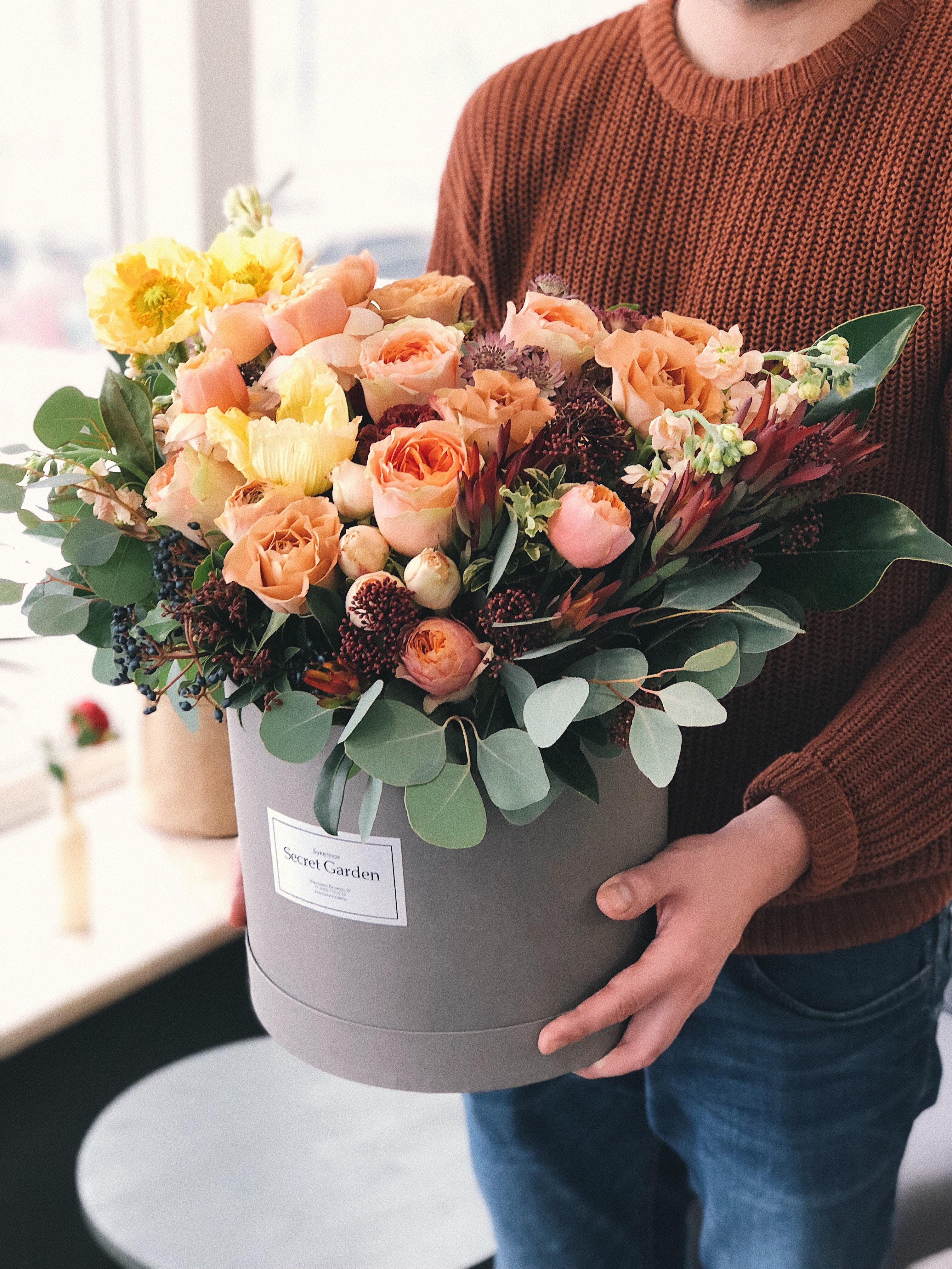Orange tulips in gray plant pot photo