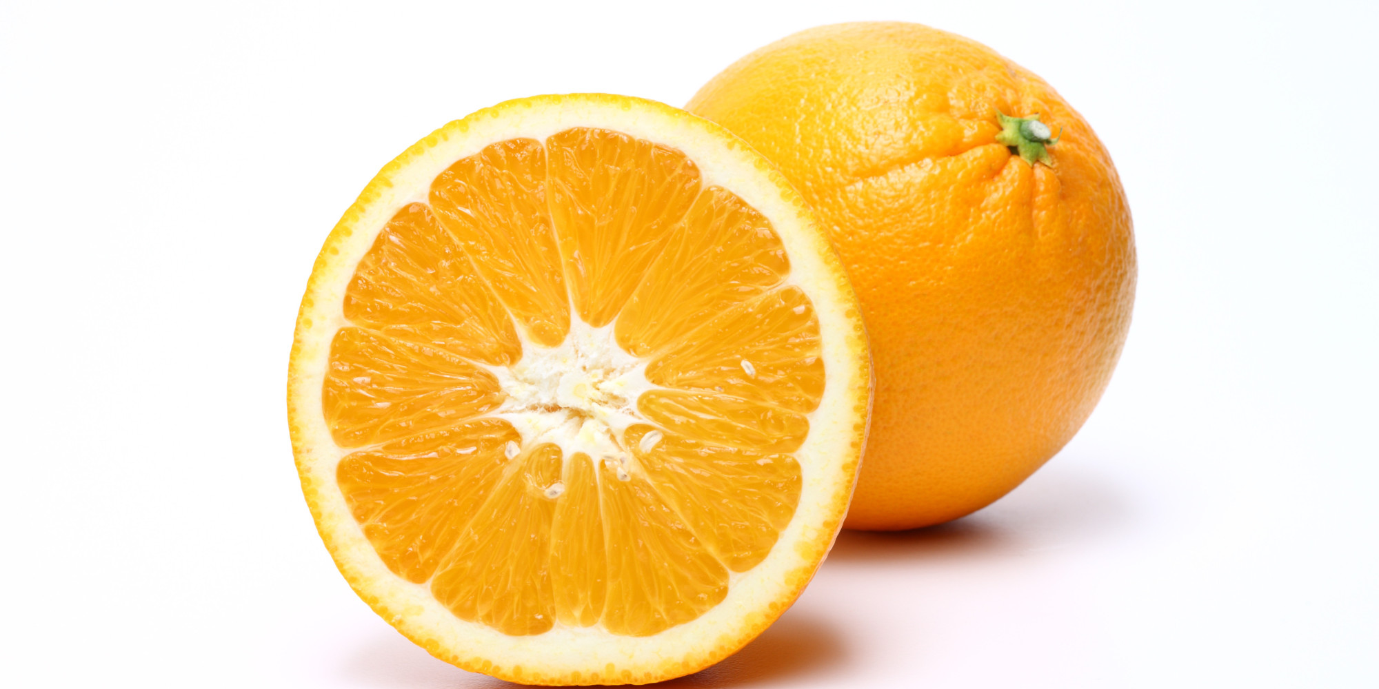 Peeled juicy oranges photo