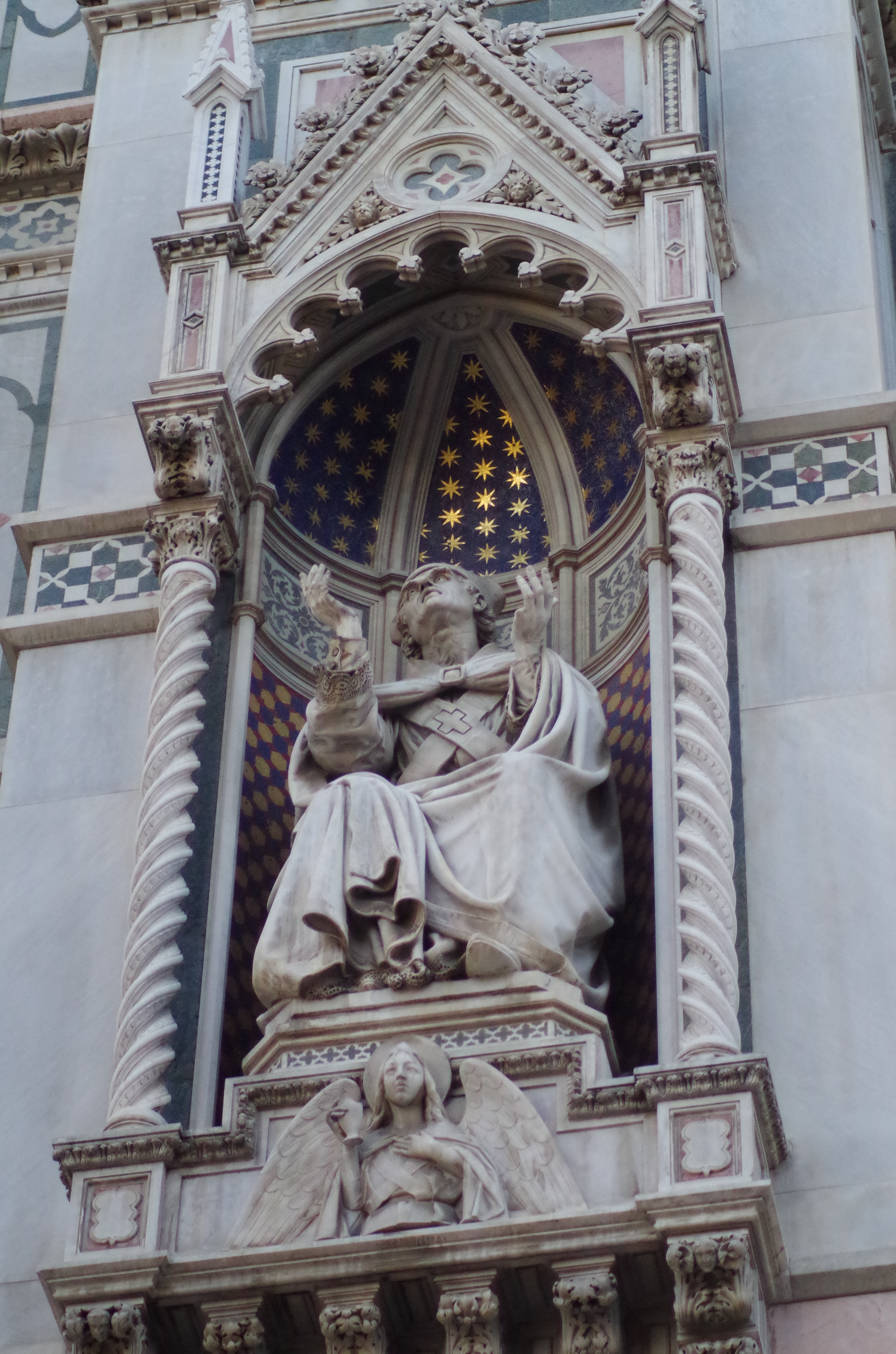 Ornate statue of person in robes photo