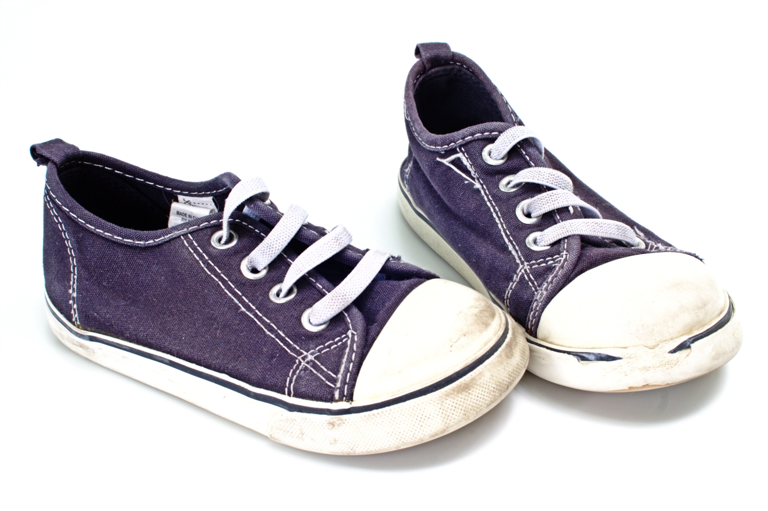 Pair of blue and white sneakers photo