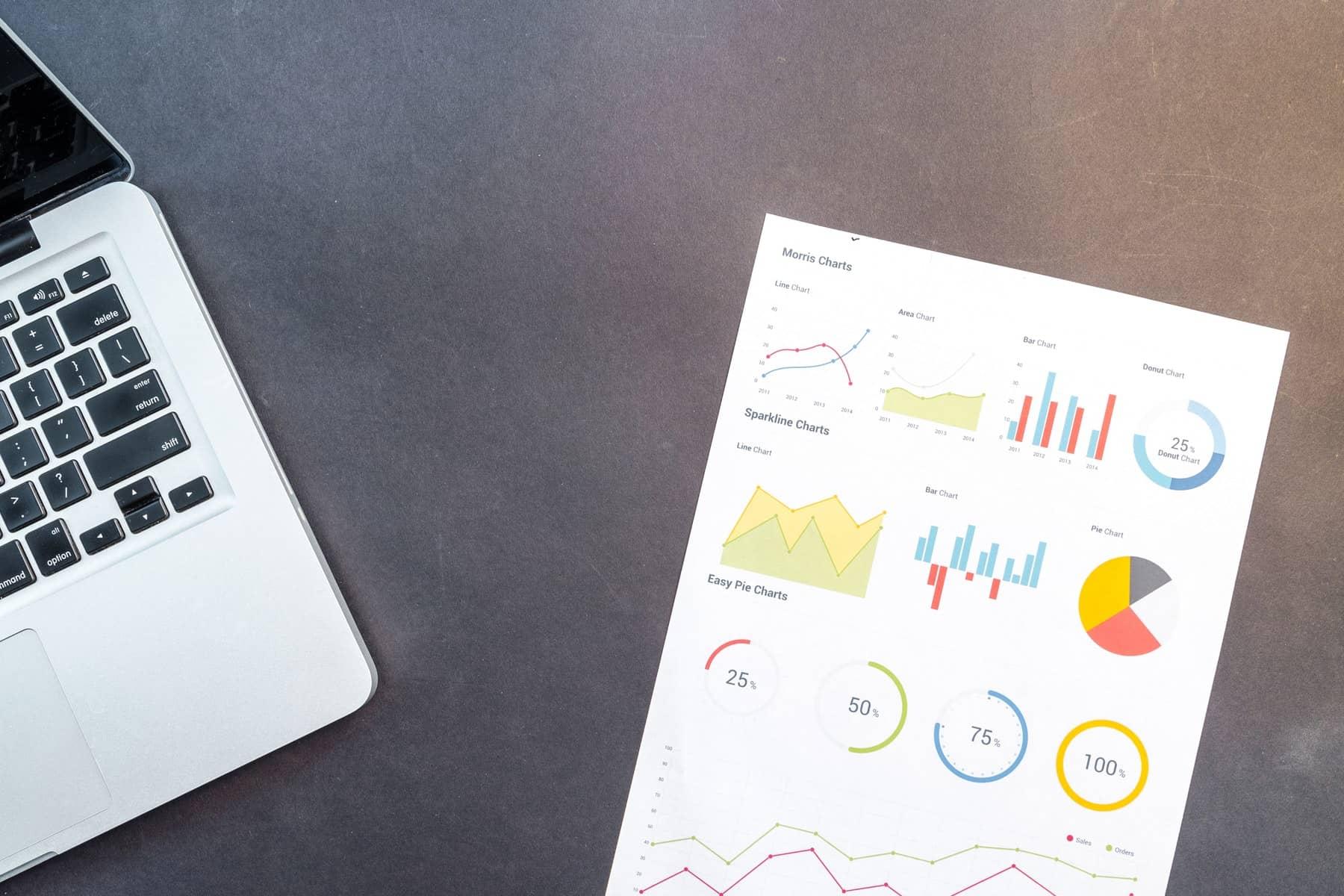 Paper beside Macbook useful features Excel | AM 18 Consultancy