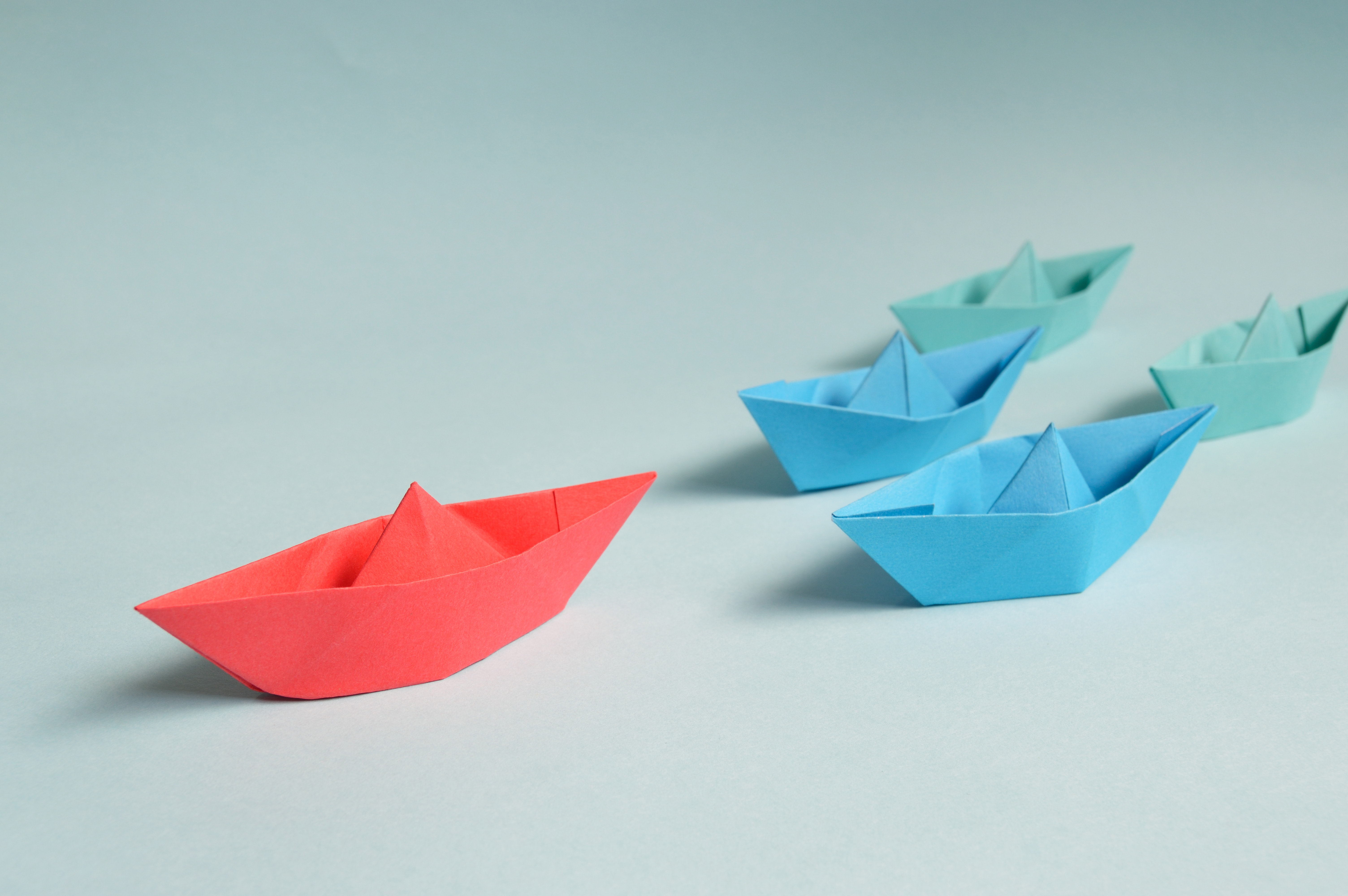 Paper boats on solid surface photo