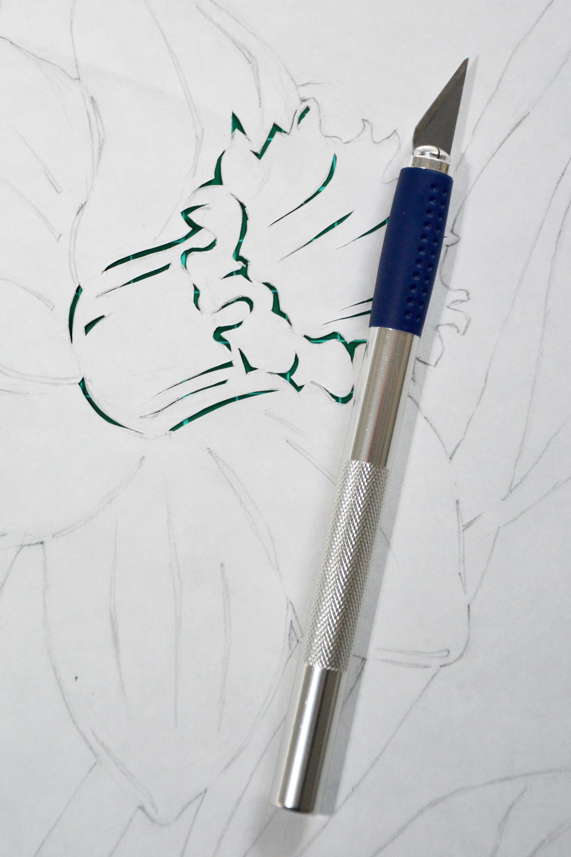 Paper cutting in progress photo